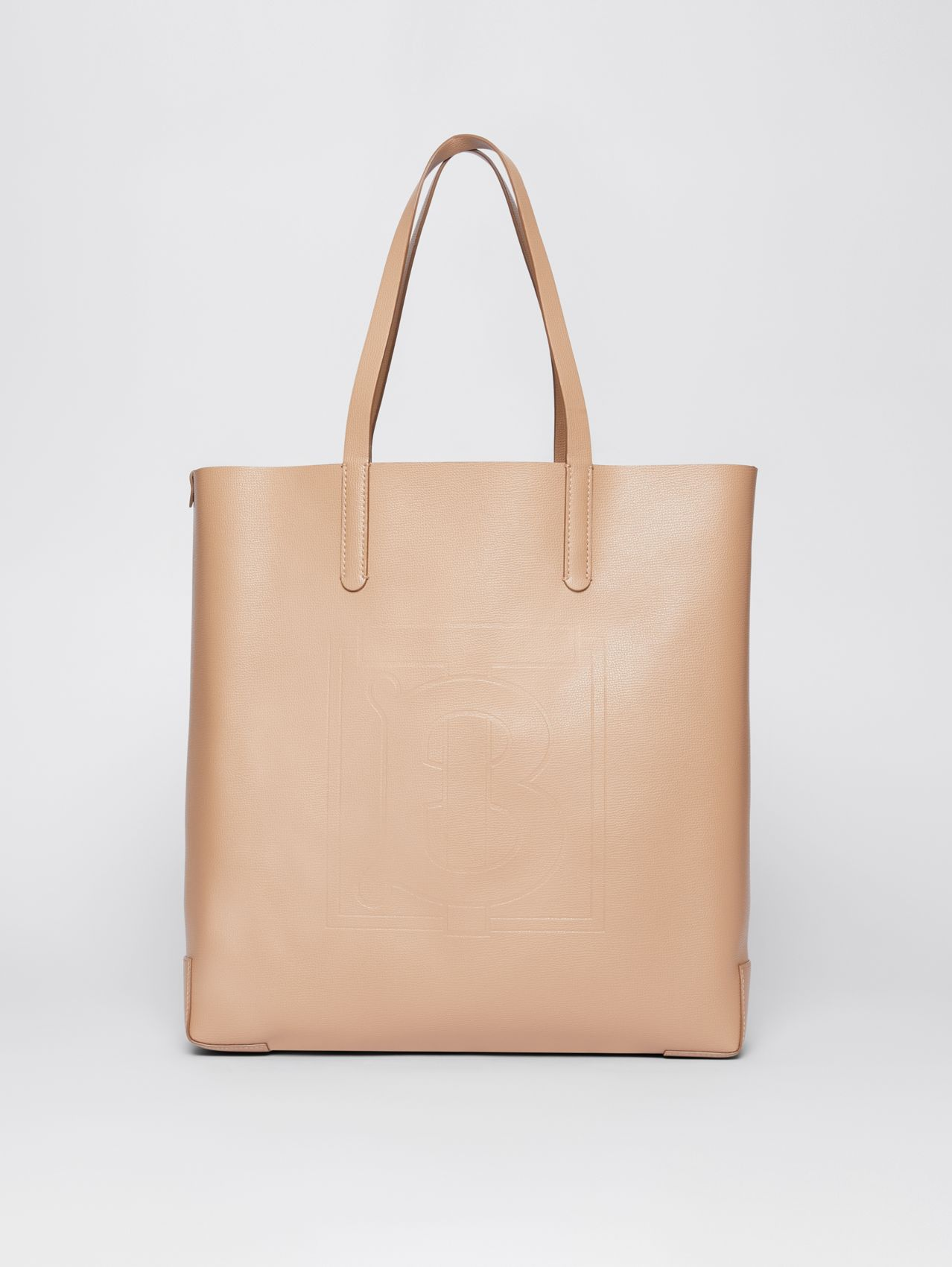 Large Embossed Monogram Motif Leather Tote in Camel