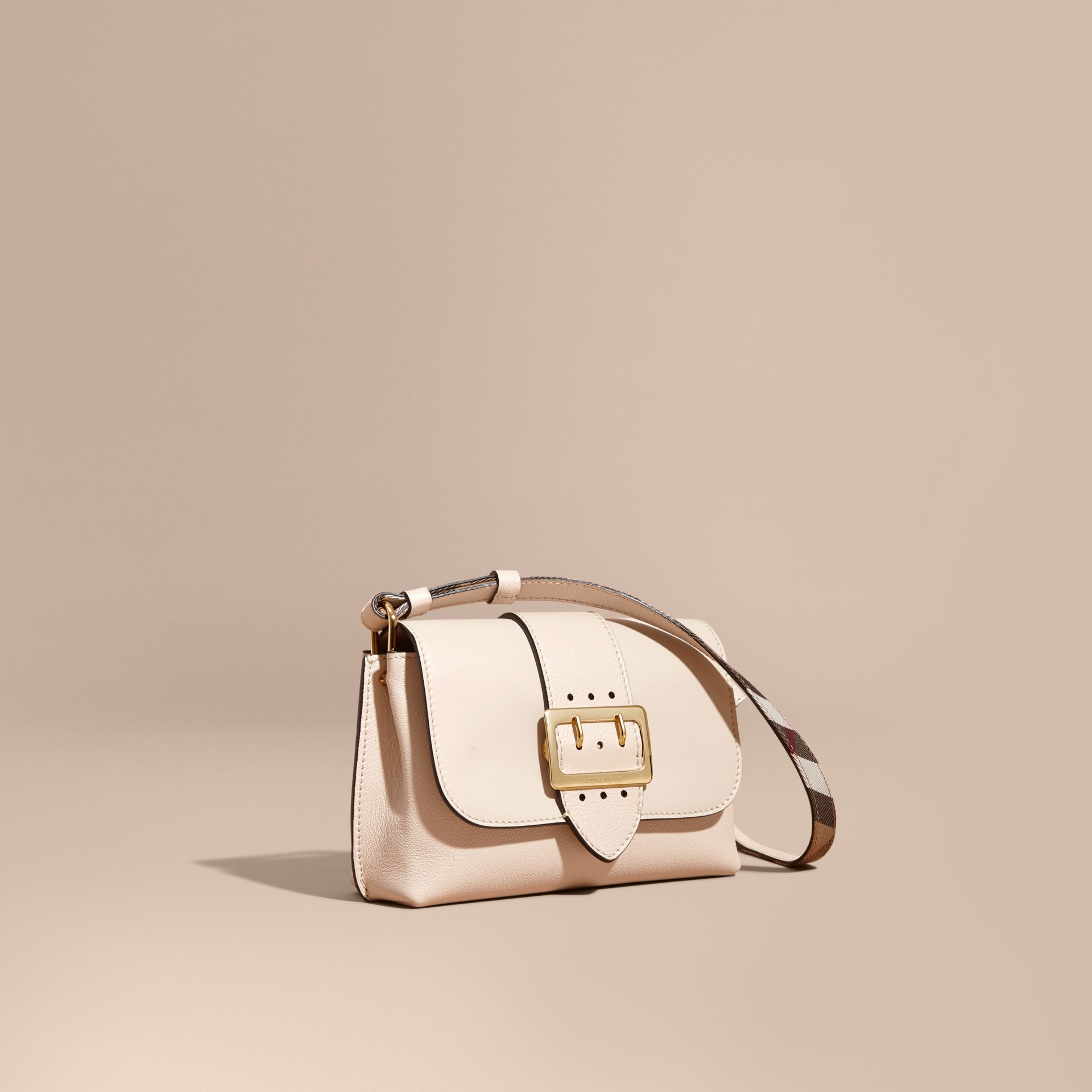 The Buckle Crossbody Bag in Leather in Limestone - gallery image 1