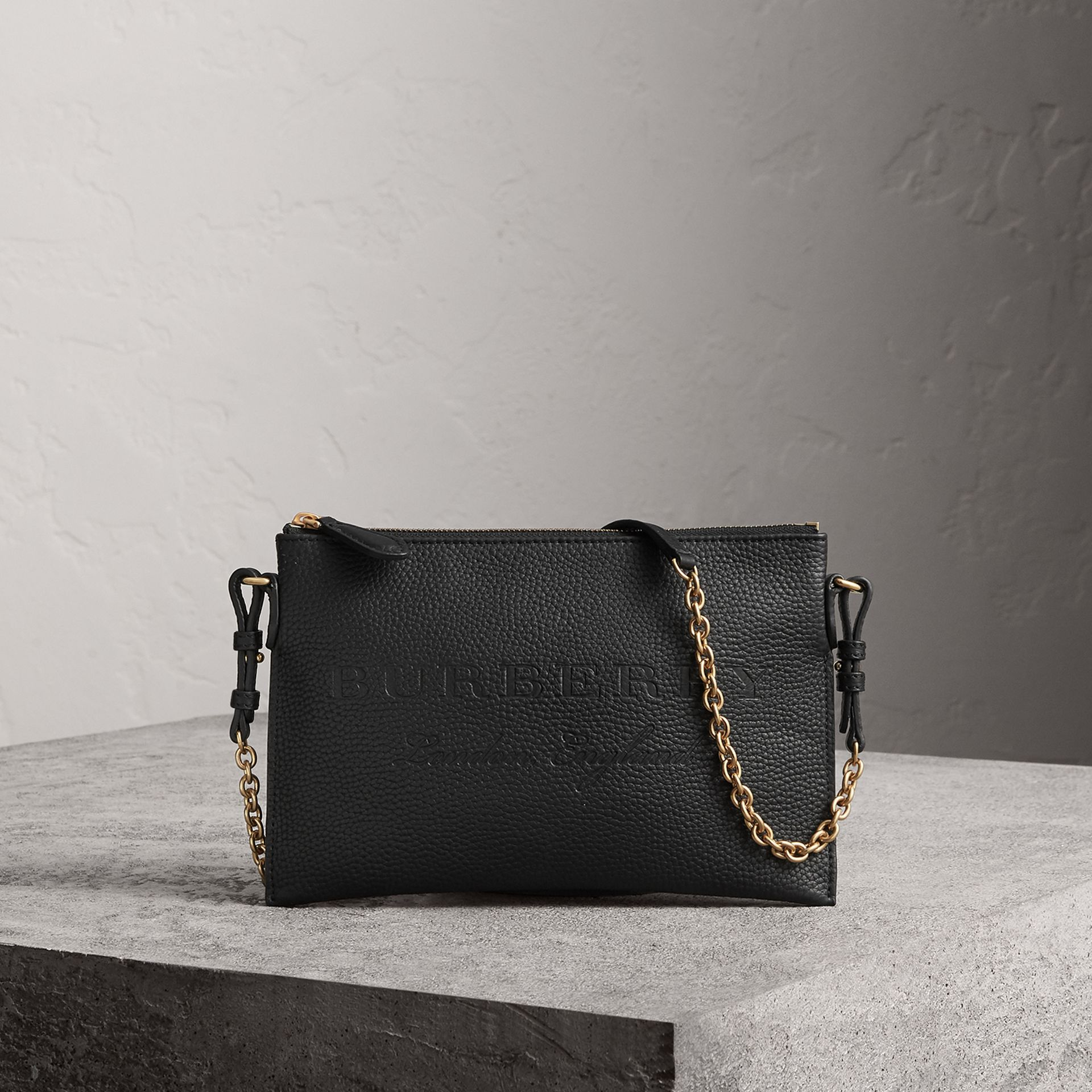 Embossed Leather Clutch Bag in Black - Women | Burberry United Kingdom - gallery image 0