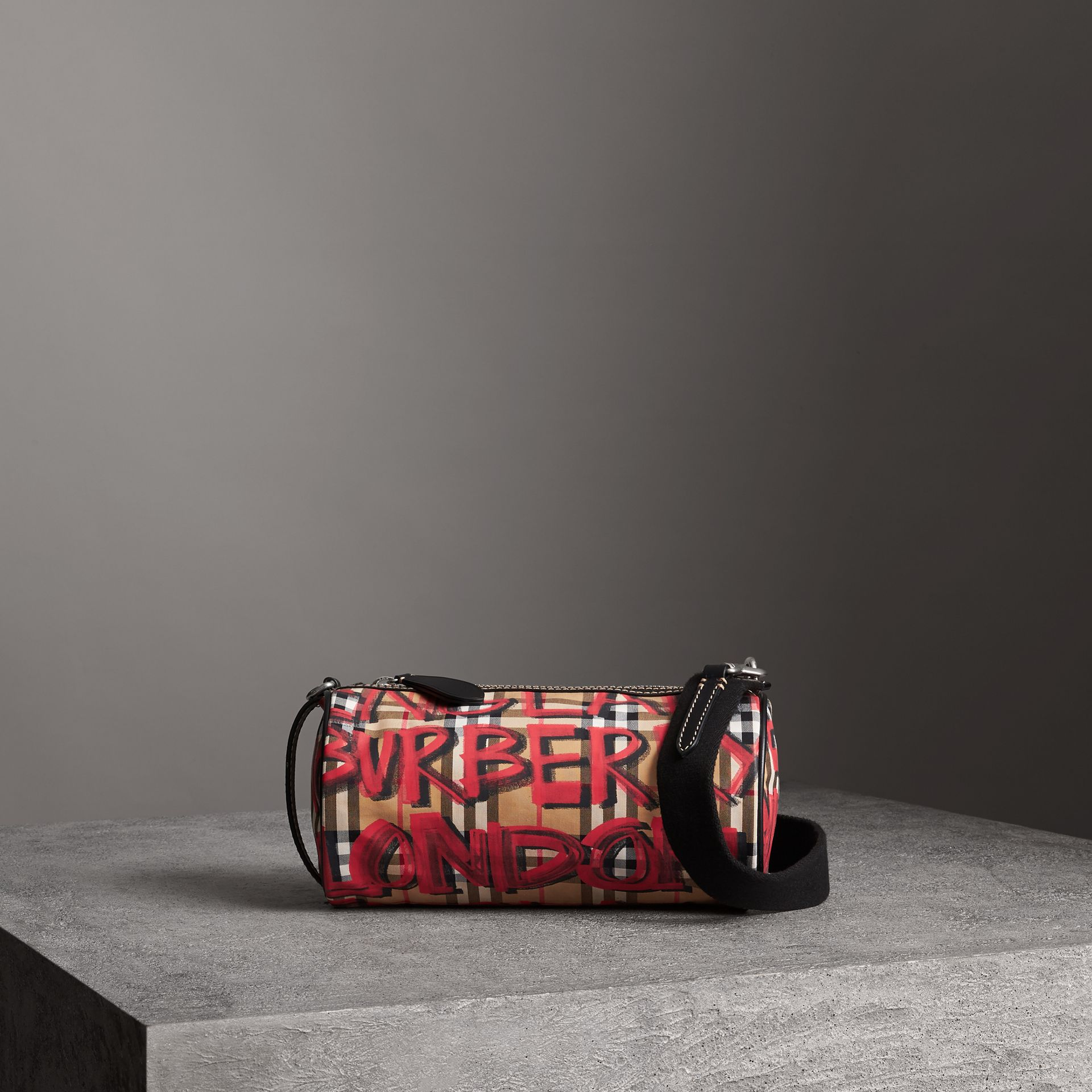 The Small Graffiti Print Vintage Check Barrel Bag in Black - Women | Burberry - gallery image 0