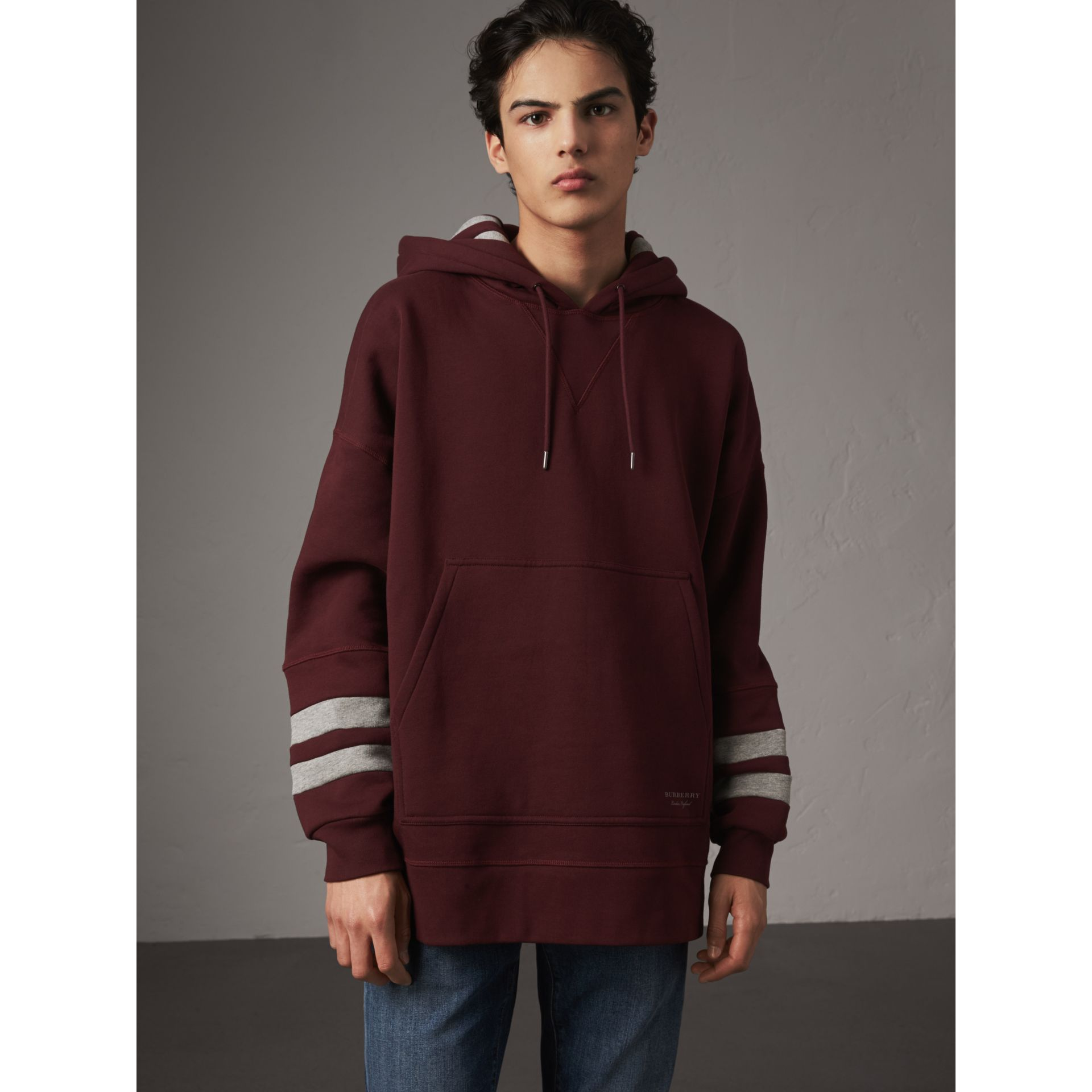 Bold Stripe Detail Oversize Hooded Sweatshirt in Deep Claret - Men | Burberry United Kingdom - gallery image 1