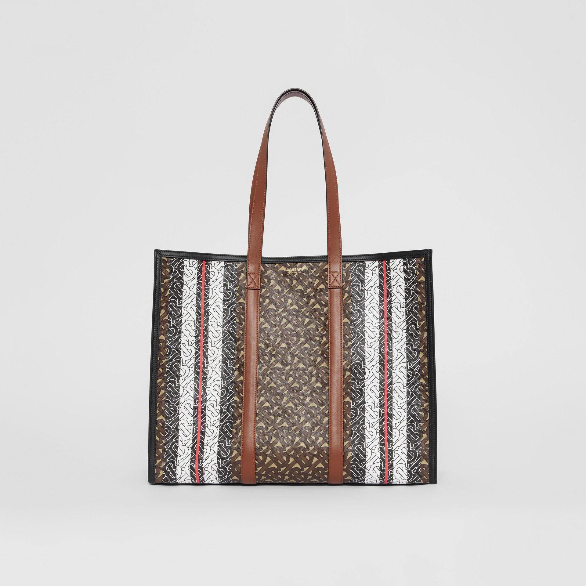 Monogram Stripe E-canvas Tote Bag in Bridle Brown | Burberry - gallery image 0