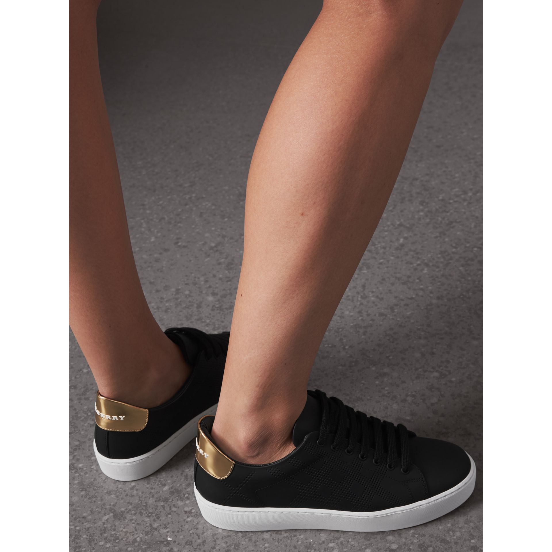 Perforated Check Leather Sneakers in Black - Women | Burberry United Kingdom - gallery image 2