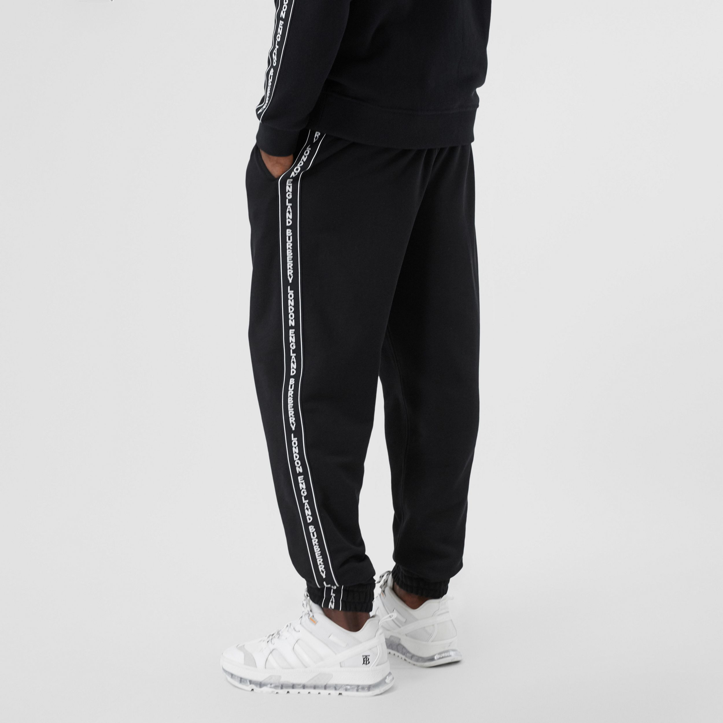 Logo Tape Cotton Jogging Pants in Black - Men | Burberry Singapore - 3