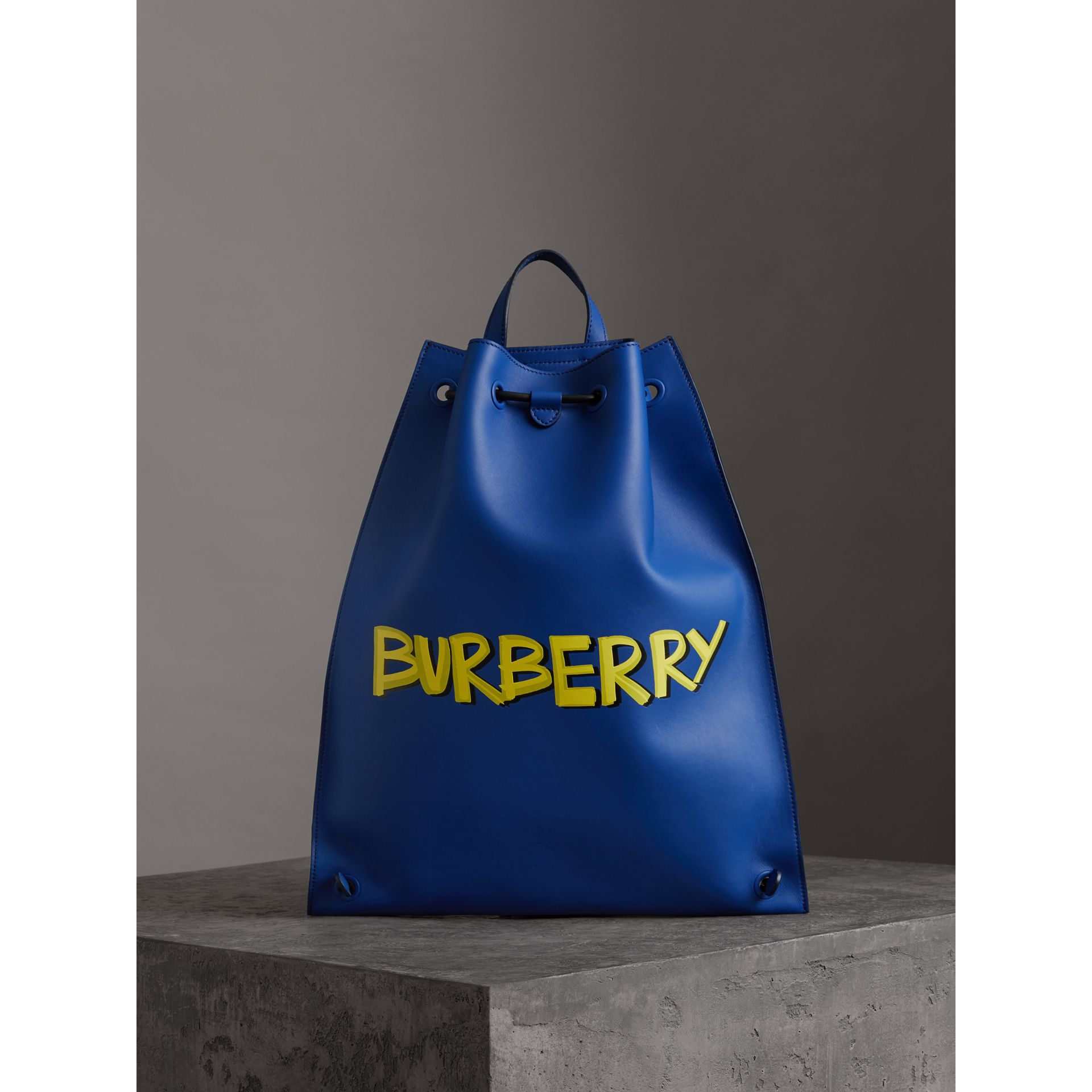 Graffiti Print Bonded Leather Drawcord Backpack in Denim Blue - Men | Burberry United States - gallery image 4