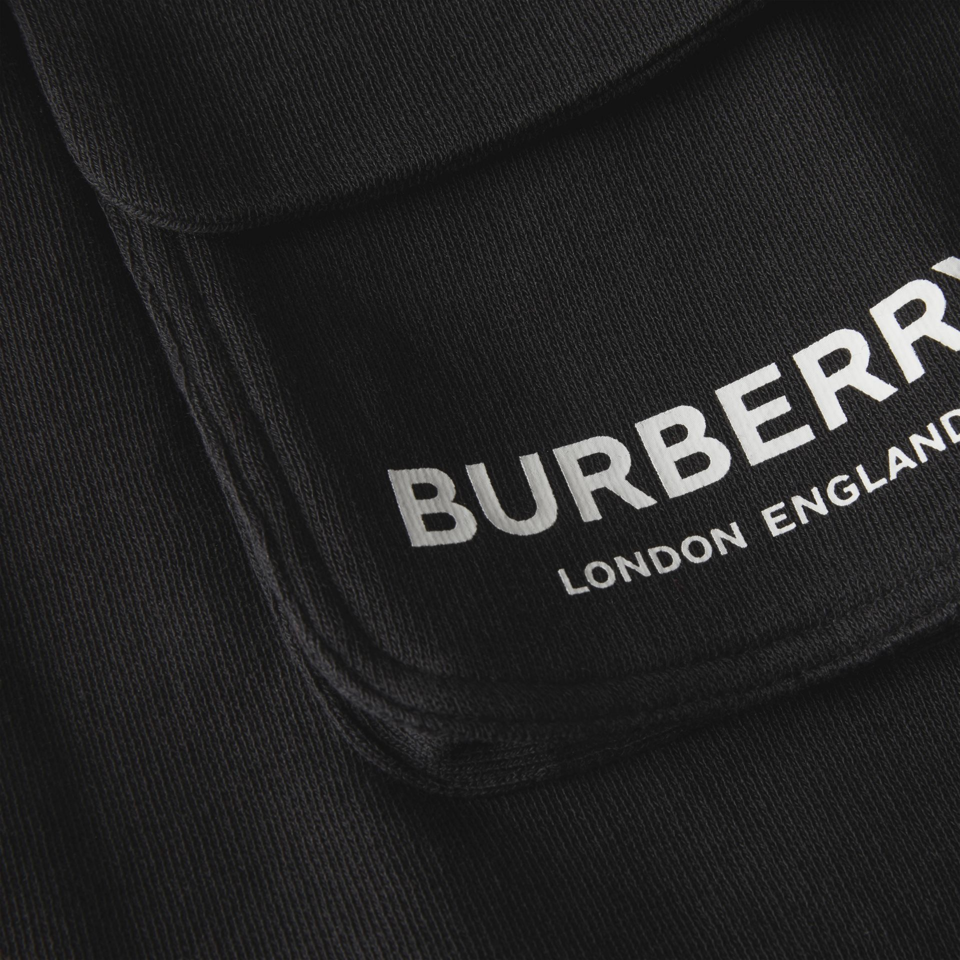 Logo Print Cotton Drawcord Shorts in Black | Burberry - gallery image 1