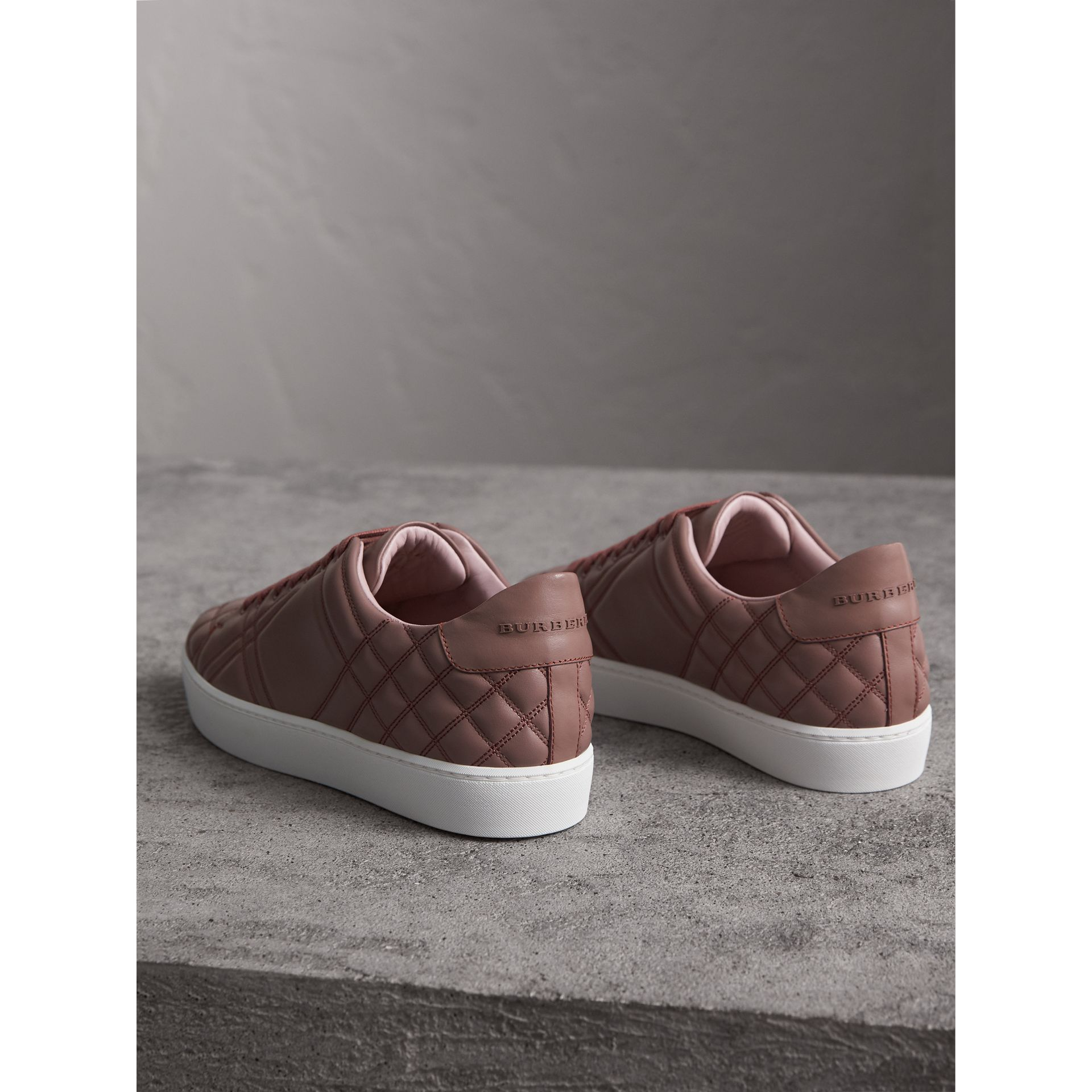 Check-quilted Leather Trainers in Ivory Pink - Women | Burberry - gallery image 3