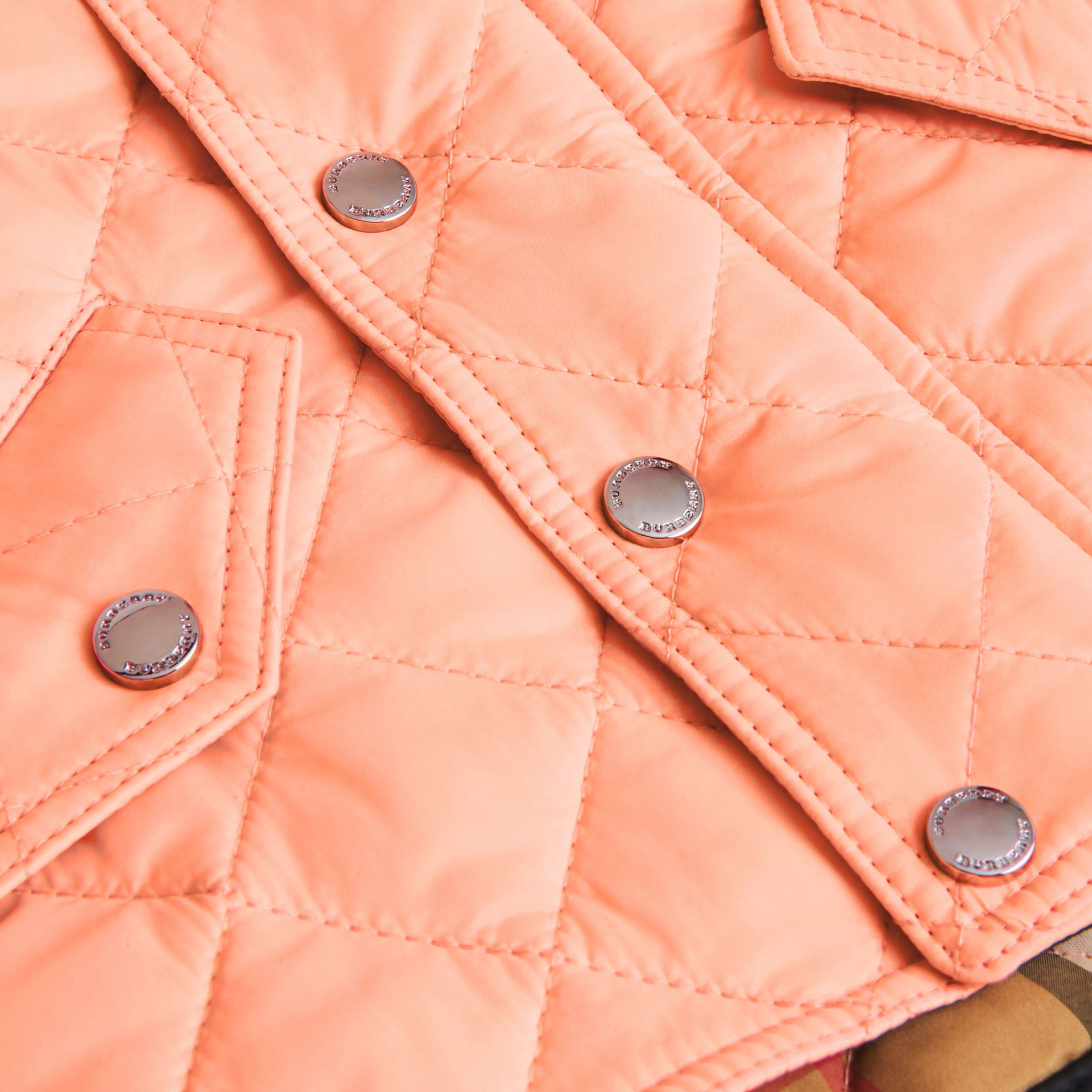 Diamond Quilted Hooded Jacket in Apricot Pink - Children | Burberry United Kingdom - gallery image 1