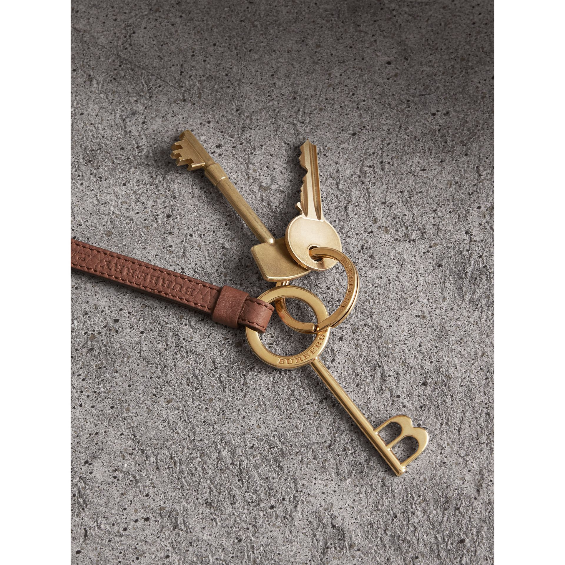 Burberry Motif Metal and Leather Strap Key Charm in Chestnut Brown | Burberry - gallery image 1