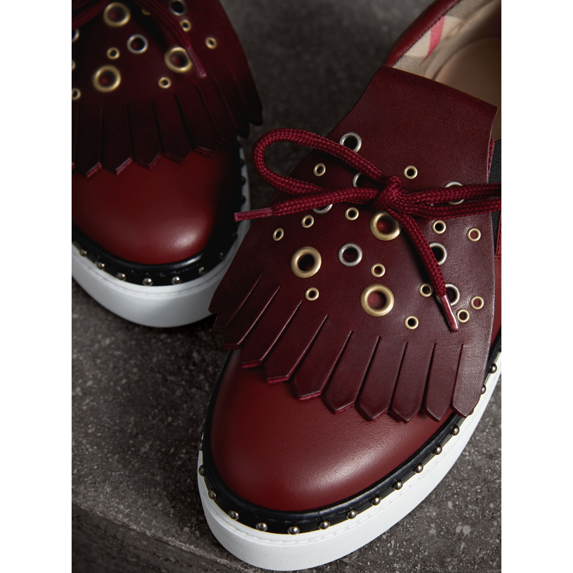 Kiltie Fringe Leather Sneakers in Cerise Purple - Women | Burberry Canada - gallery image 1
