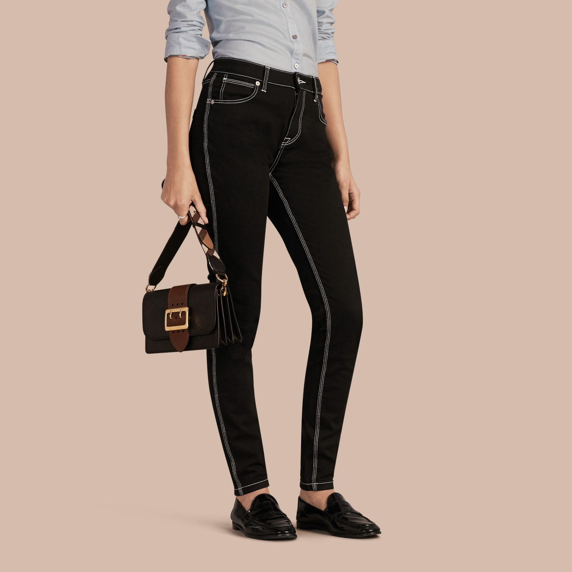 Black Skinny Fit Stretch Jeans with Contrast Topstitching - gallery image 1