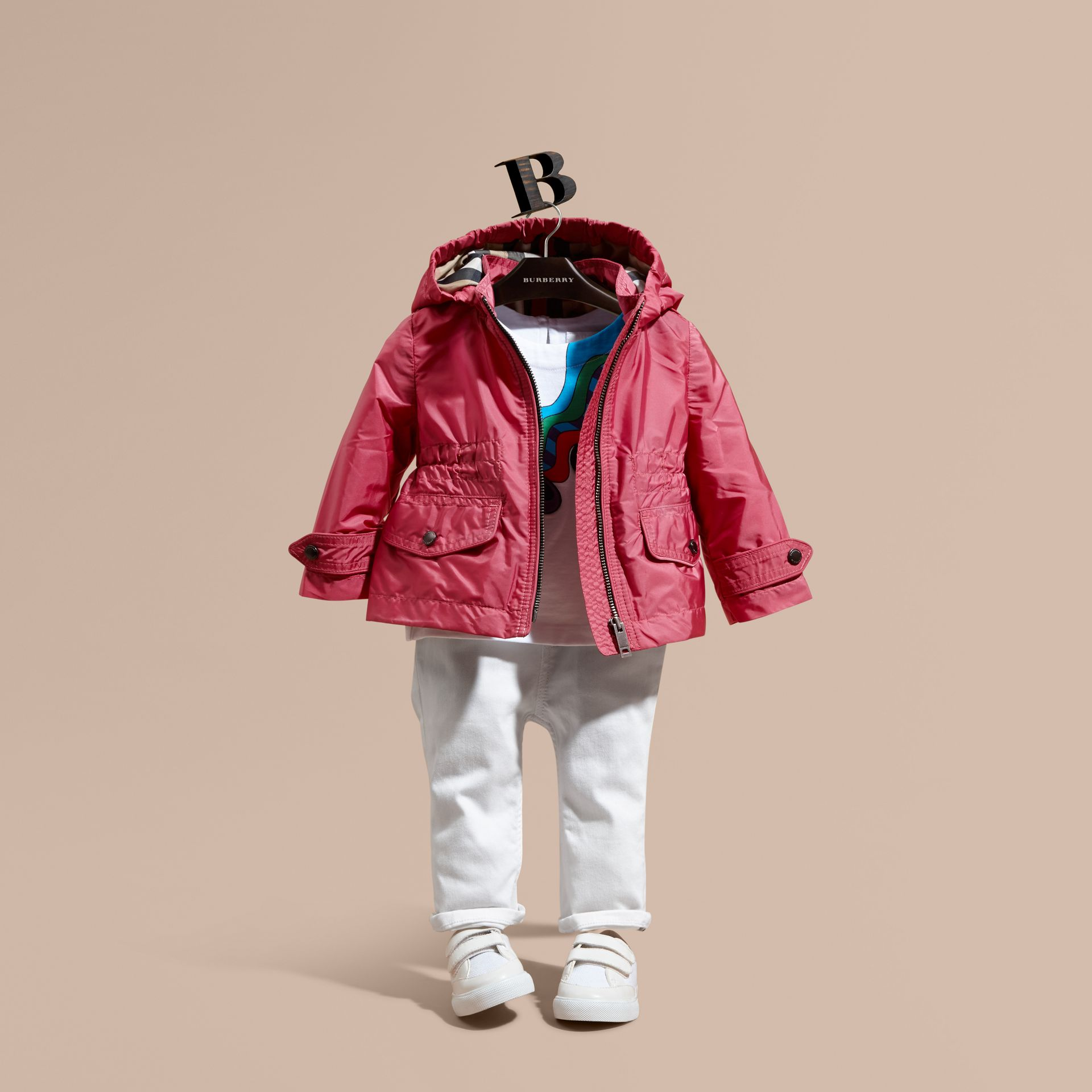 Hooded Packaway Technical Jacket in Pink Azalea - gallery image 1