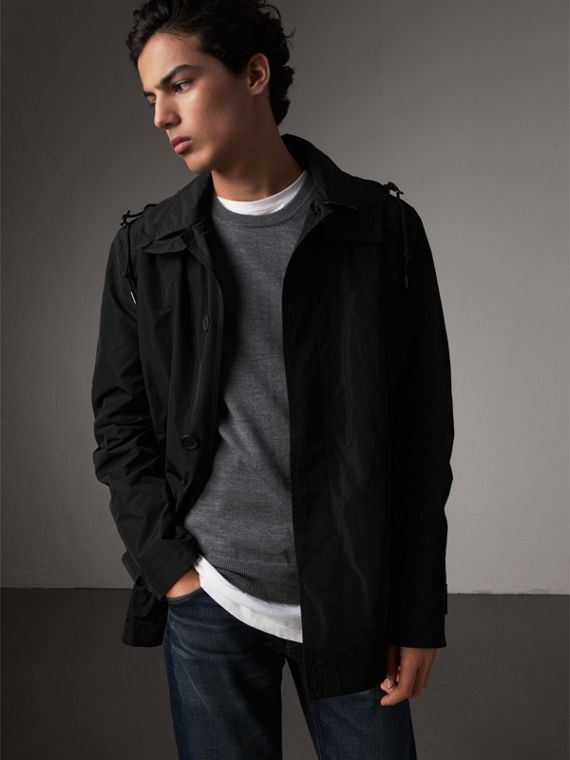 Showerproof Hooded Jacket with Removable Warmer in Black