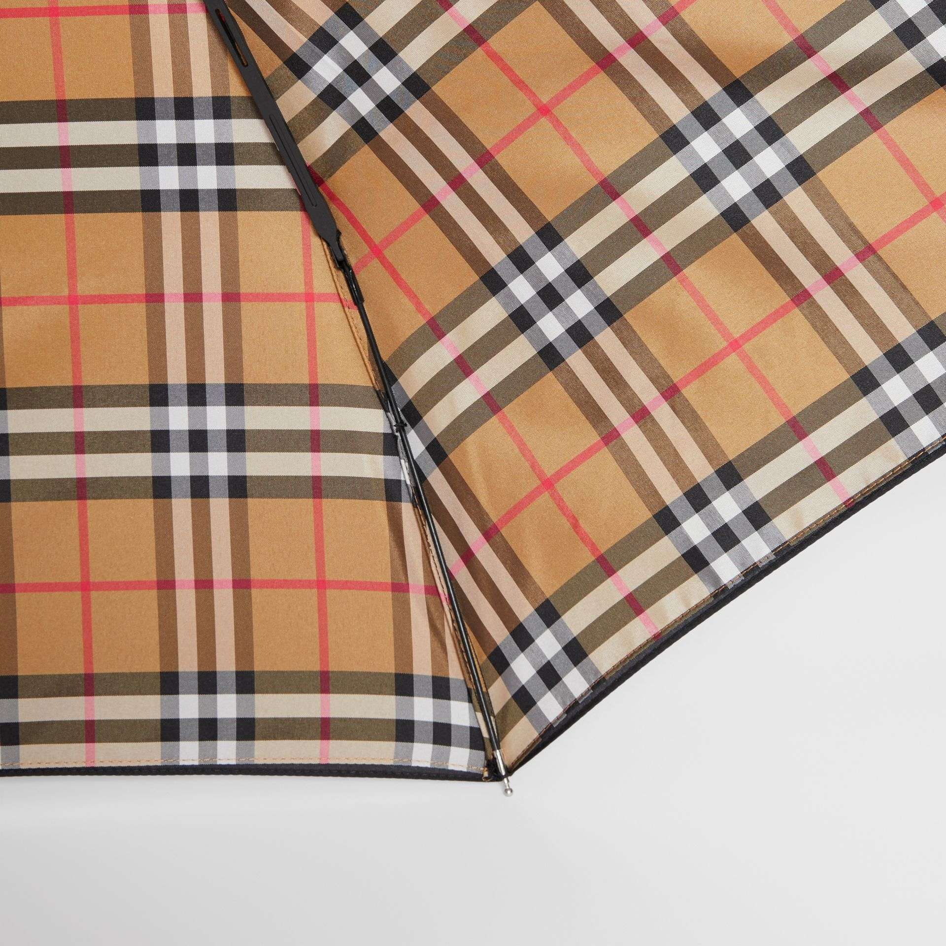 Vintage Check-lined Folding Umbrella in Black | Burberry - gallery image 1