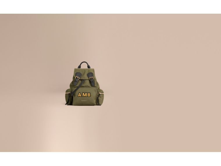 The Medium Rucksack in Technical Nylon and Leather Canvas Green - cell image 1