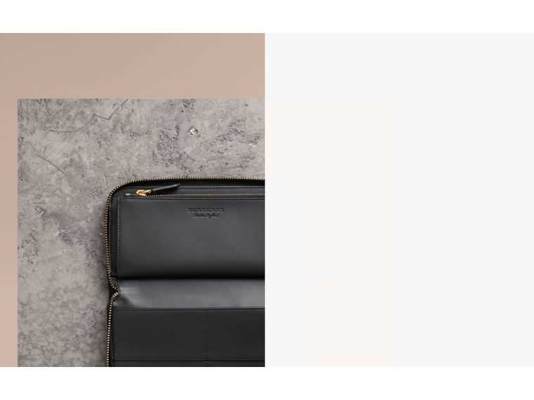 Embossed Leather Ziparound Wallet in Black | Burberry Canada - cell image 1