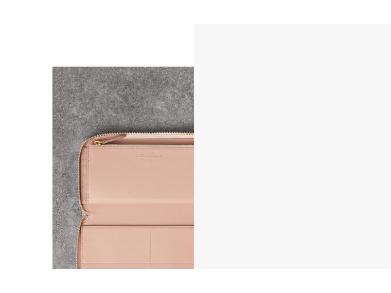 Embossed Leather Ziparound Wallet in Pale Ash Rose | Burberry Australia - cell image 1