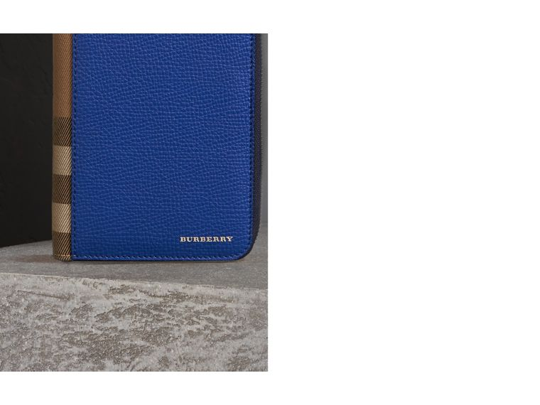 House Check and Grainy Leather Ziparound Wallet in Deep Blue | Burberry - cell image 1