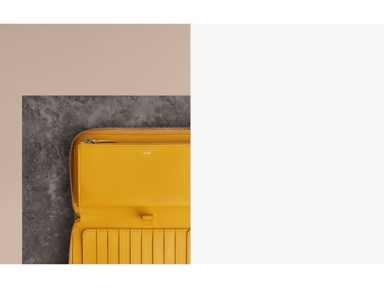 Grainy Leather Ziparound Wallet in Bright Ochre Yellow - Men | Burberry Singapore - cell image 1