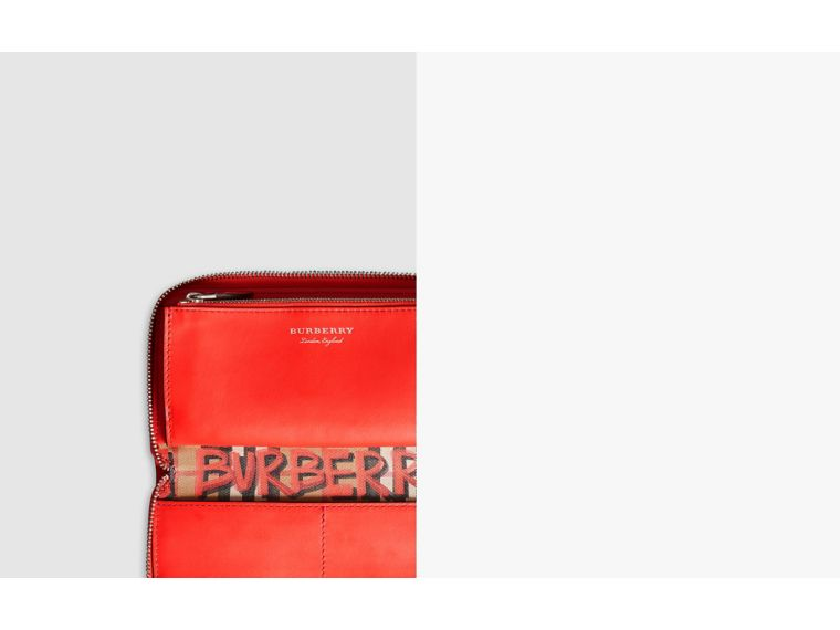 Graffiti Print Vintage Check Leather Ziparound Wallet in Red - Women | Burberry United States - cell image 1