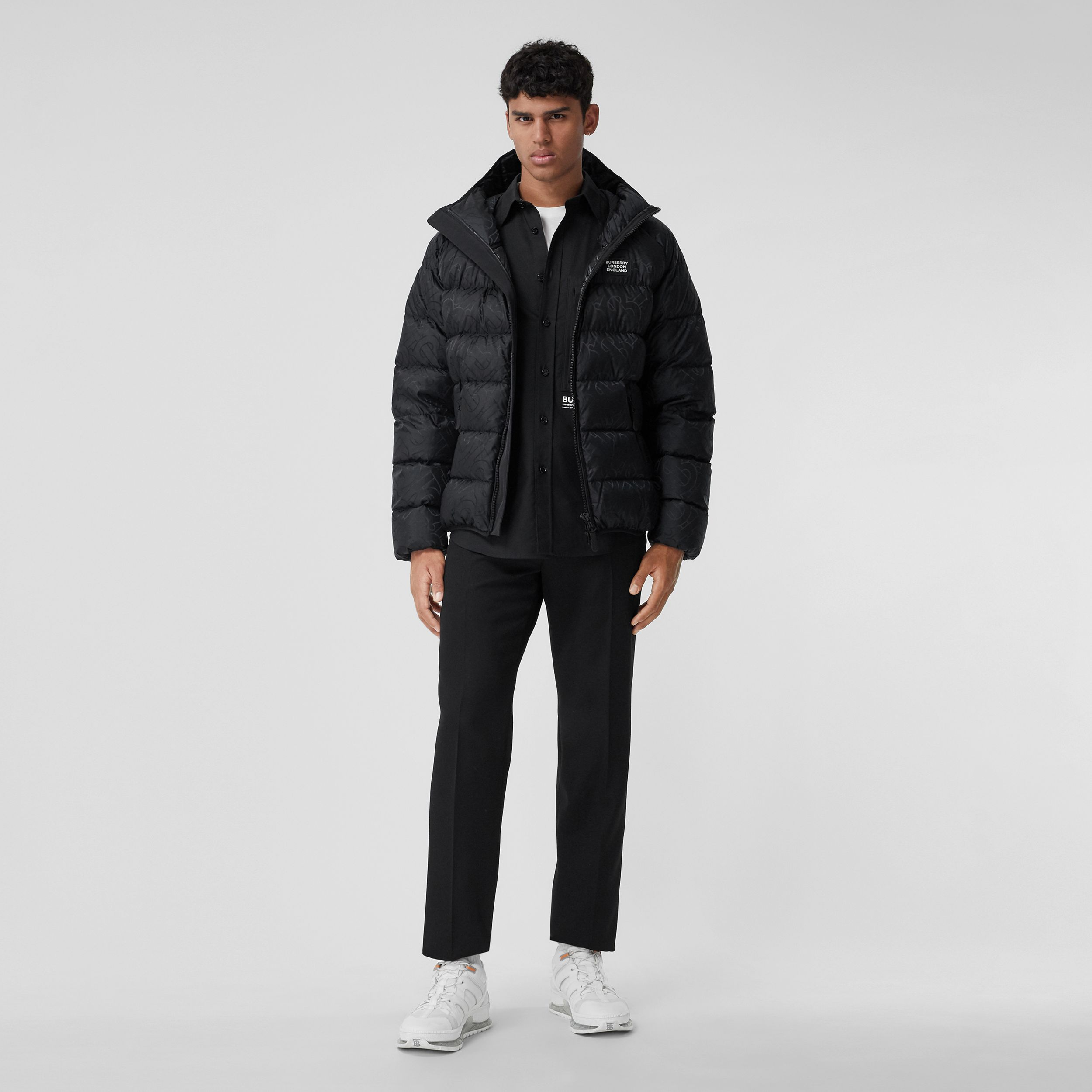 Monogram Jacquard Hooded Puffer Jacket in Black - Men | Burberry - 1
