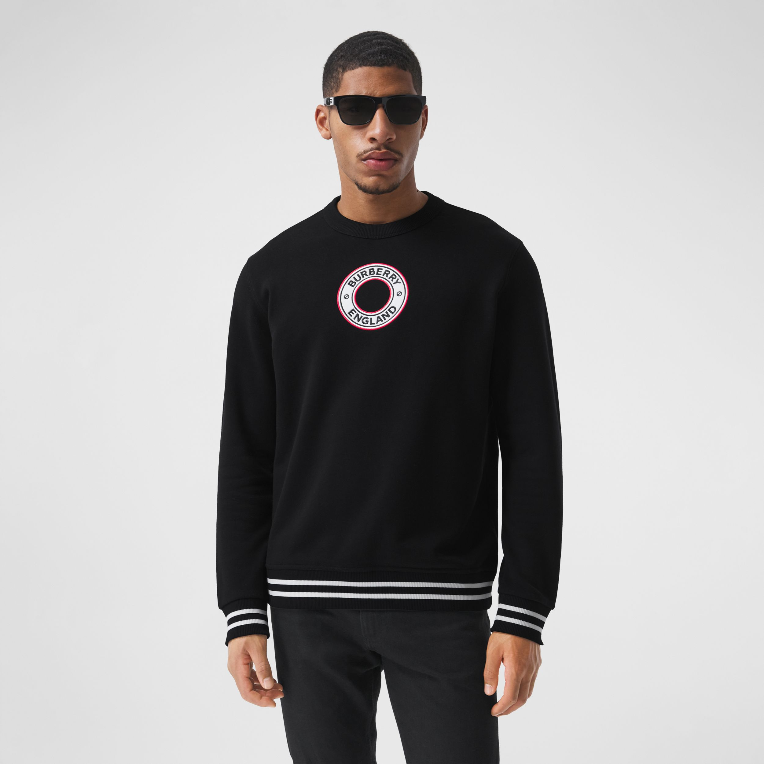 Logo Graphic Appliqué Cotton Sweatshirt in Black - Men | Burberry - 1