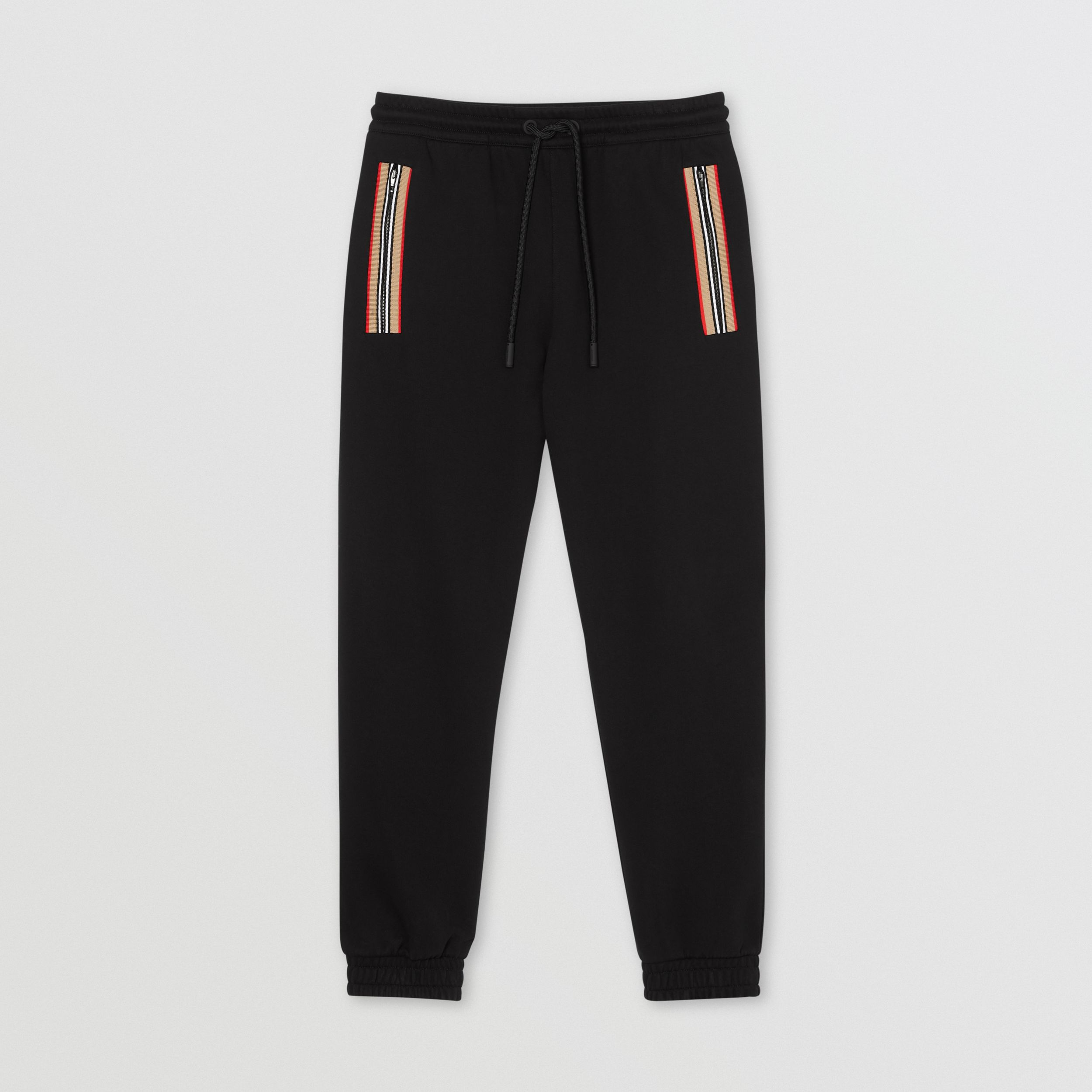 Icon Stripe Detail Cotton Jogging Pants in Black - Men | Burberry - 4