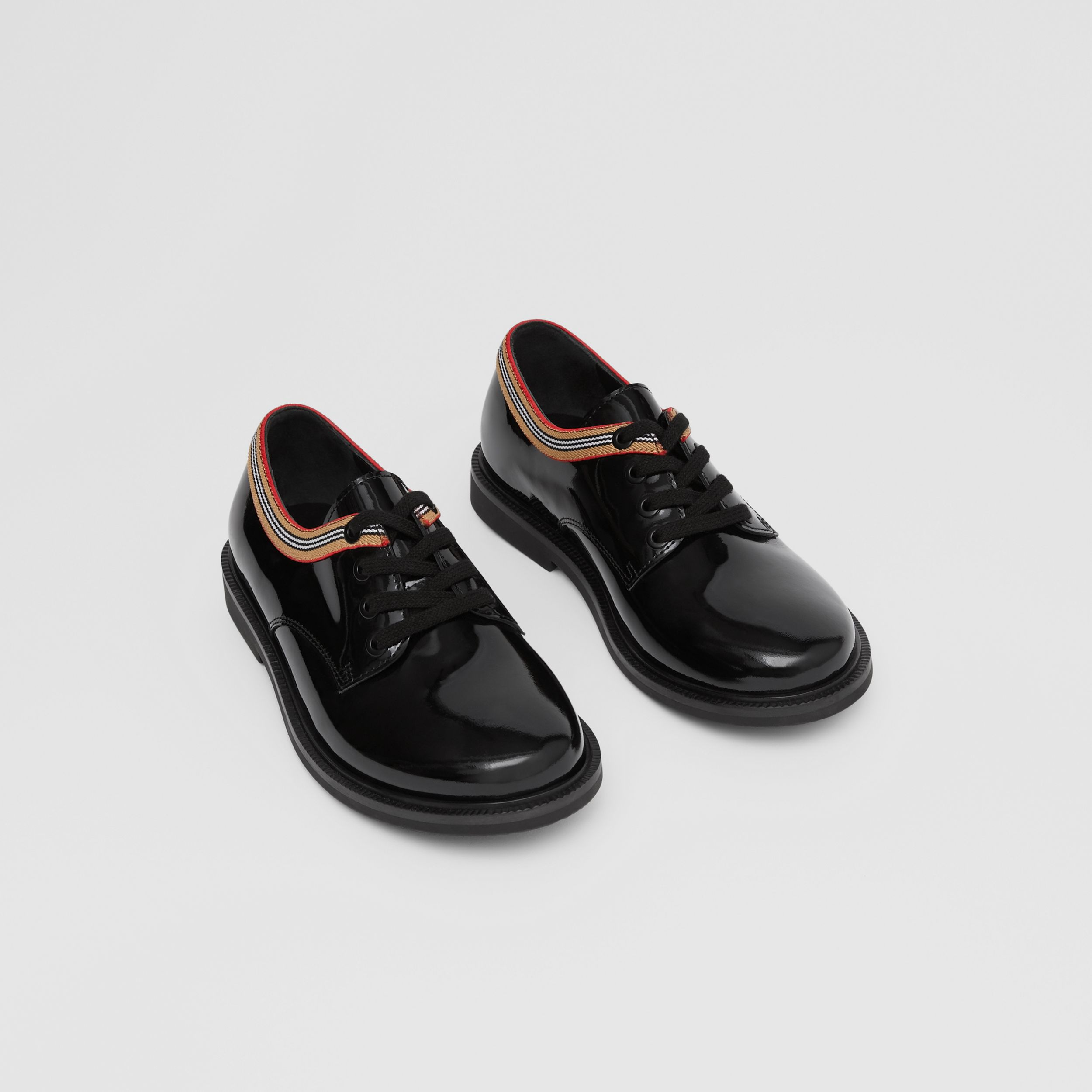 Icon Stripe Trim Patent Leather Shoes in Black - Children | Burberry - 1