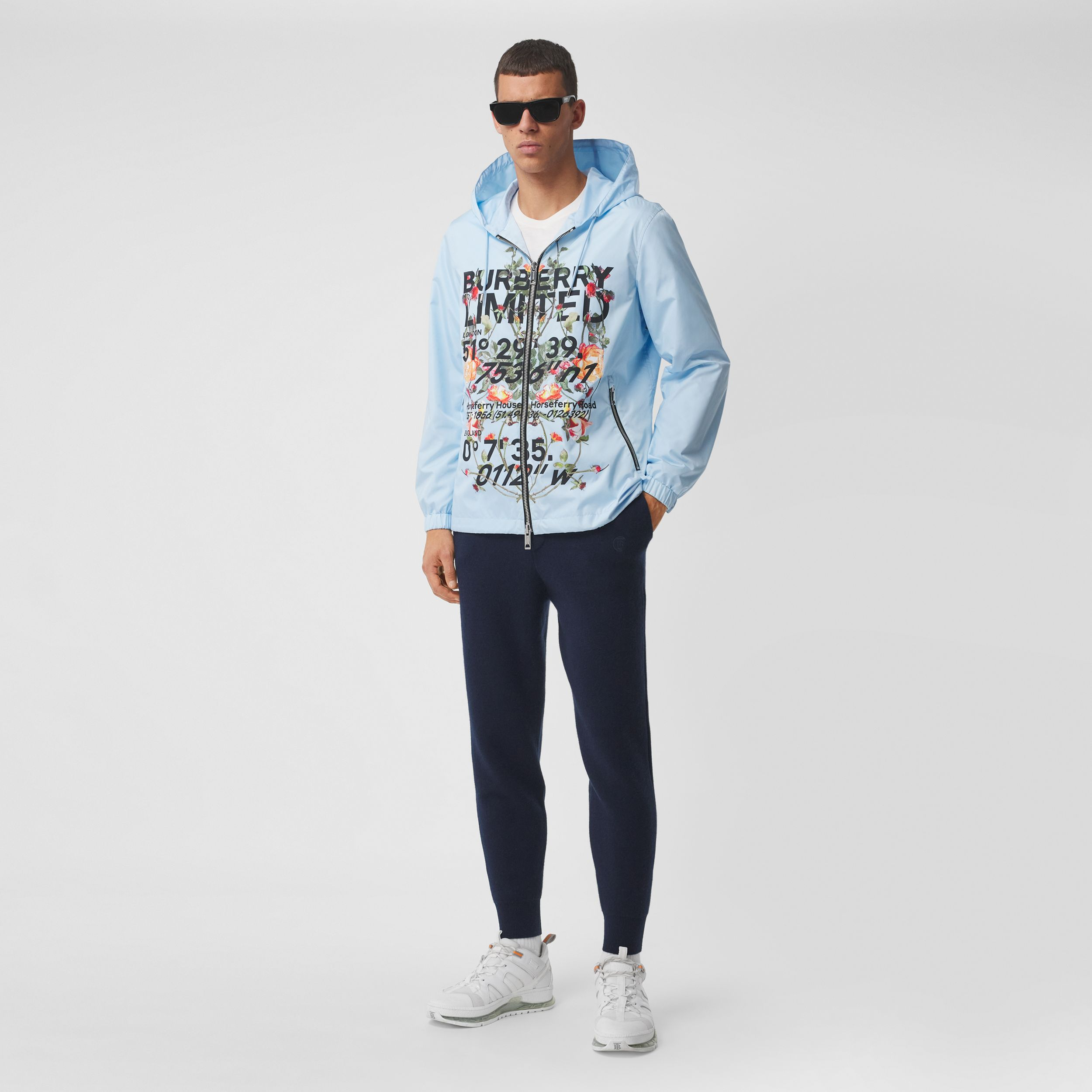 Montage Print ECONYL® Hooded Jacket in Pale Blue - Men | Burberry Hong Kong S.A.R. - 1