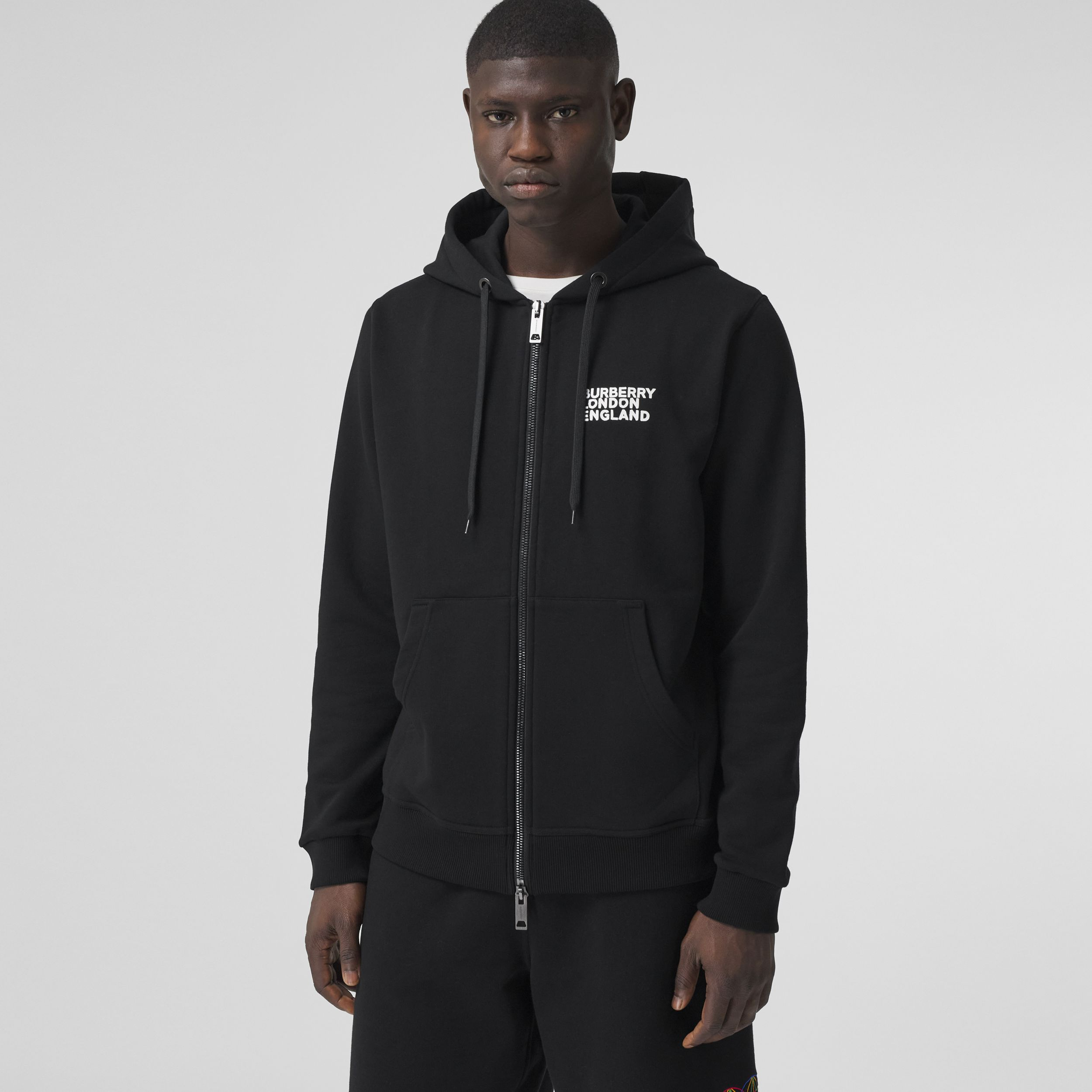 Love Print Cotton Hooded Top in Black - Men | Burberry - 1