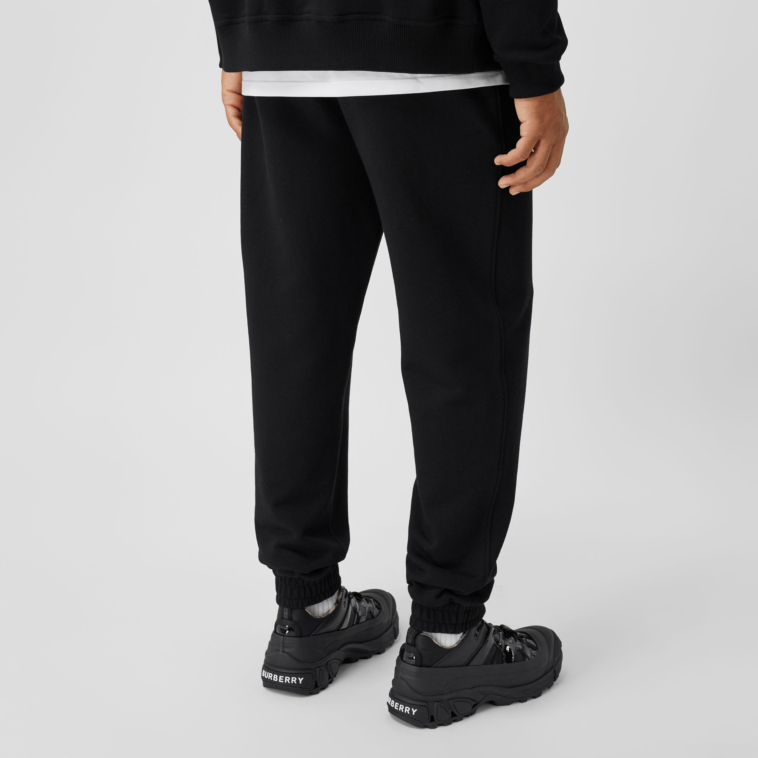 Icon Stripe Detail Cotton Jogging Pants in Black - Men | Burberry - 3