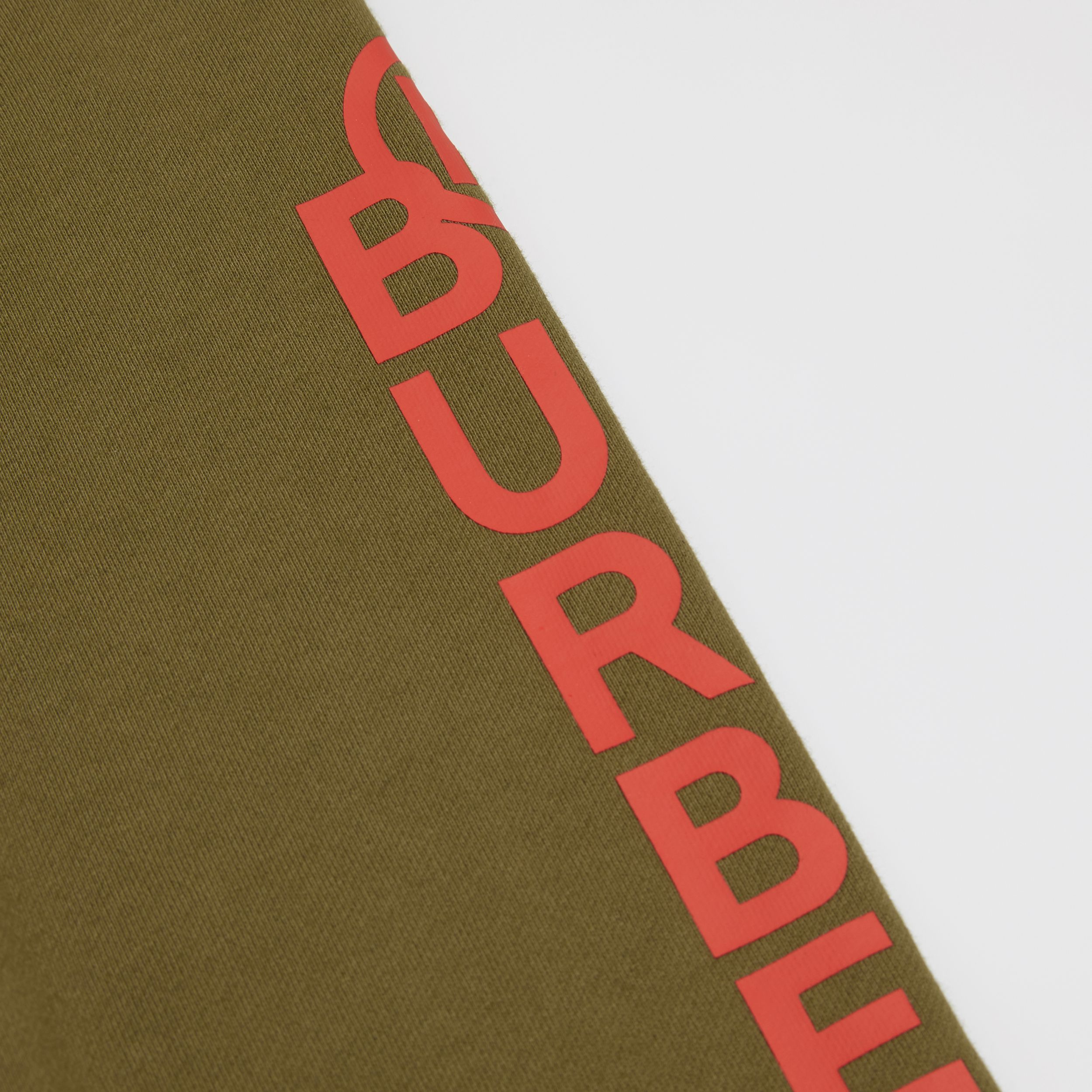 Logo and Stripe Print Cotton Jogging Pants in Khaki Green Melange | Burberry - 2