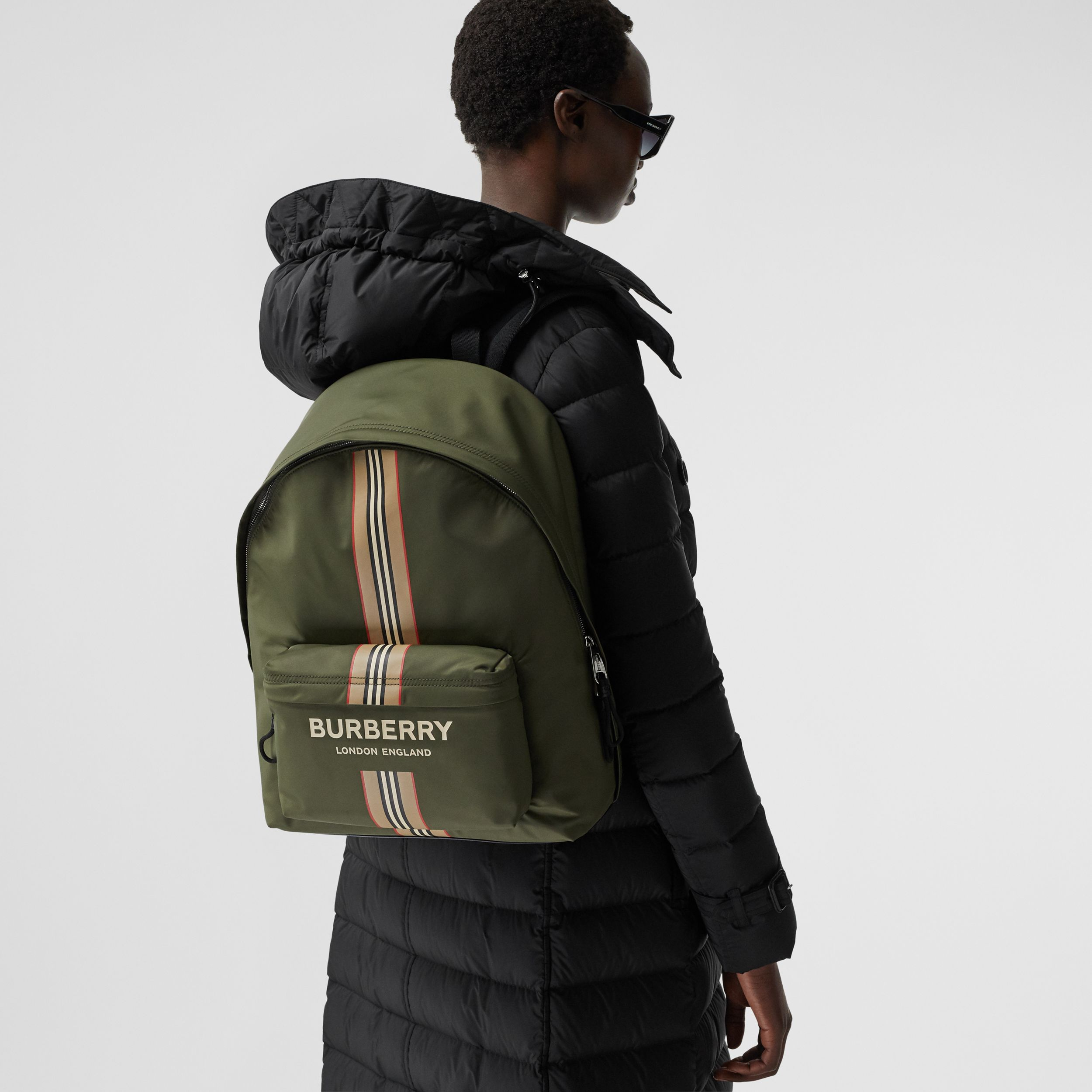 Logo and Icon Stripe Print ECONYL® Backpack in Dark Olive Green | Burberry Hong Kong S.A.R. - 3