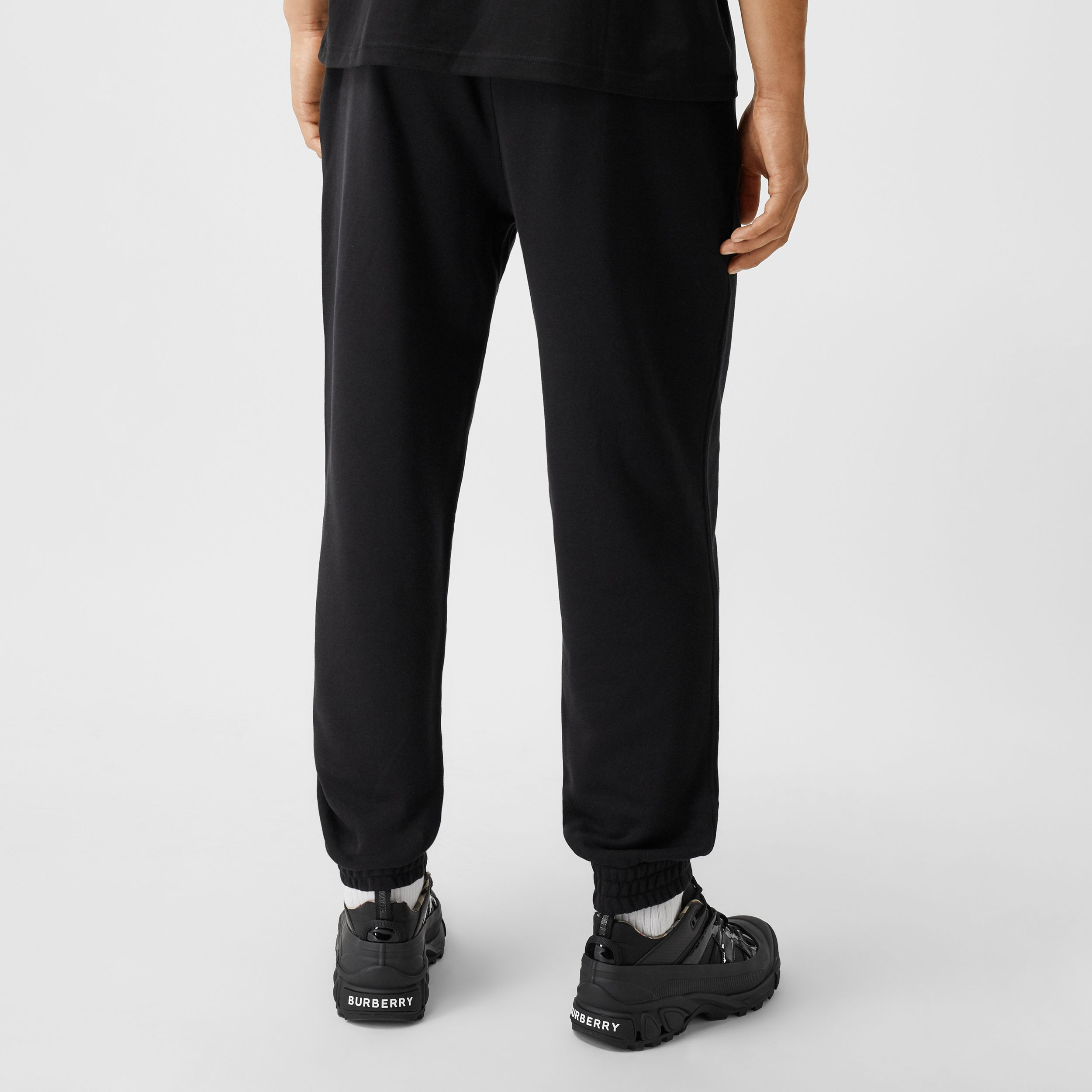Logo Graphic Cotton Jogging Pants in Black - Men | Burberry - 3