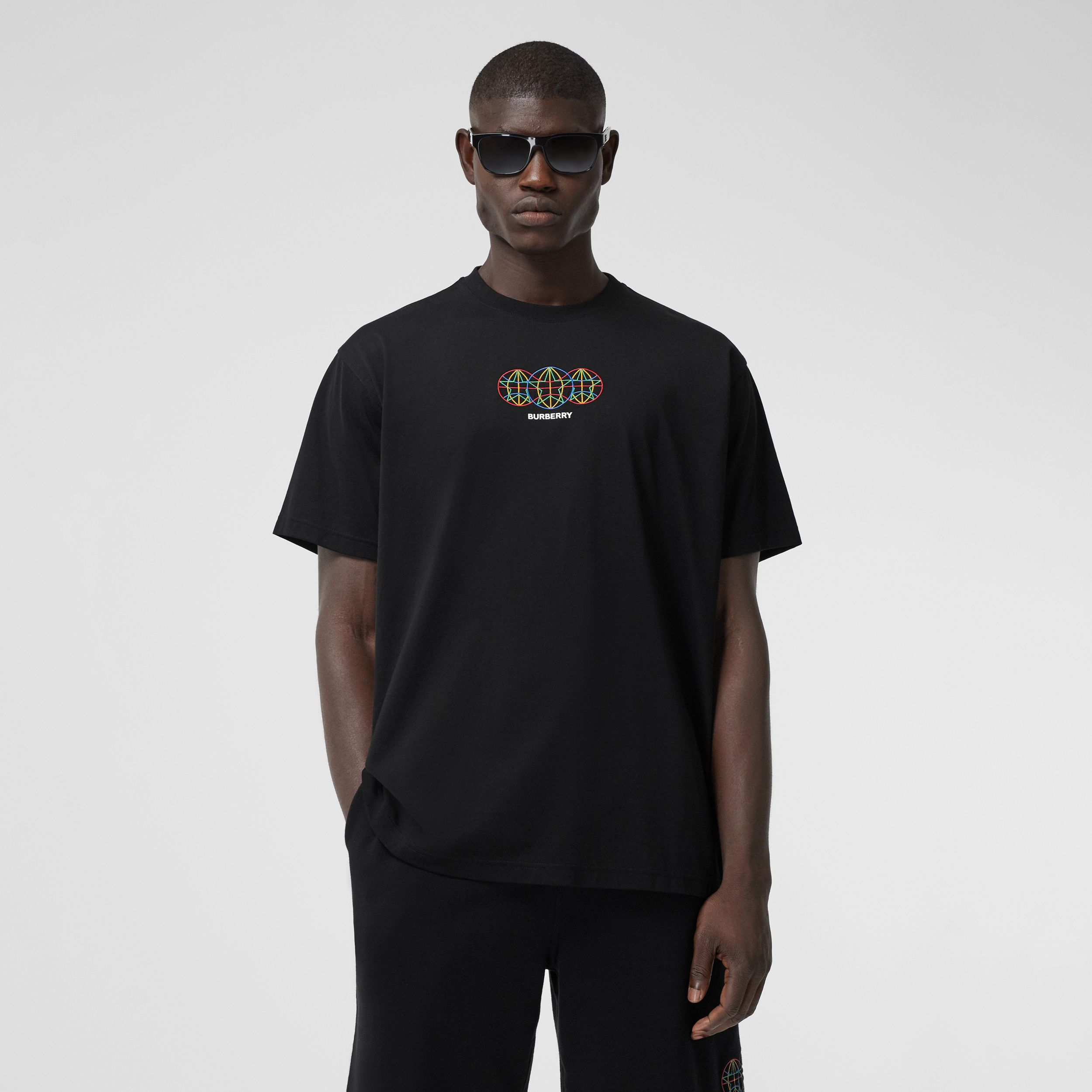 Embroidered Globe Graphic Cotton Oversized T-shirt in Black - Men | Burberry Australia - 1