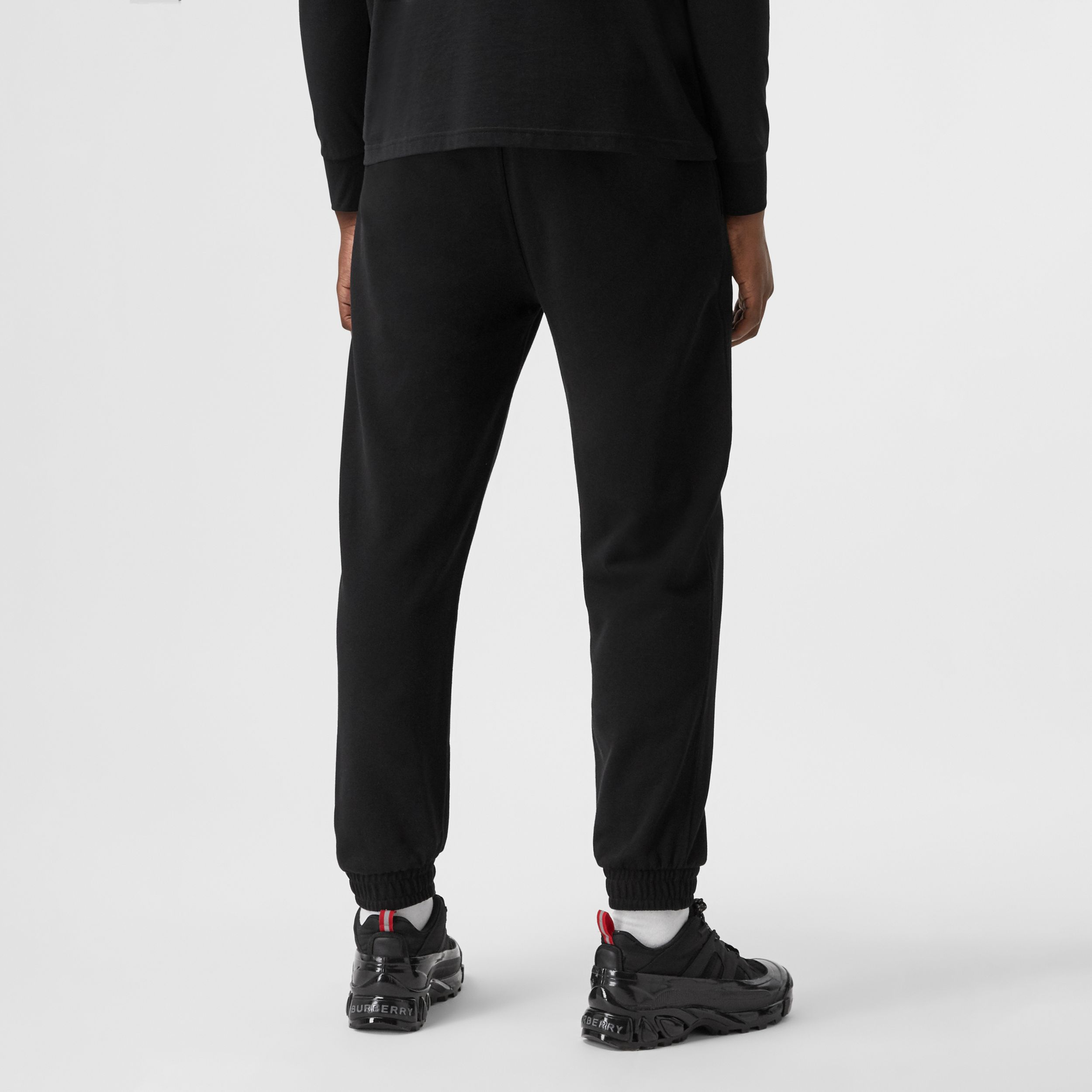 Love Print Cotton Jogging Pants in Black - Men | Burberry - 3