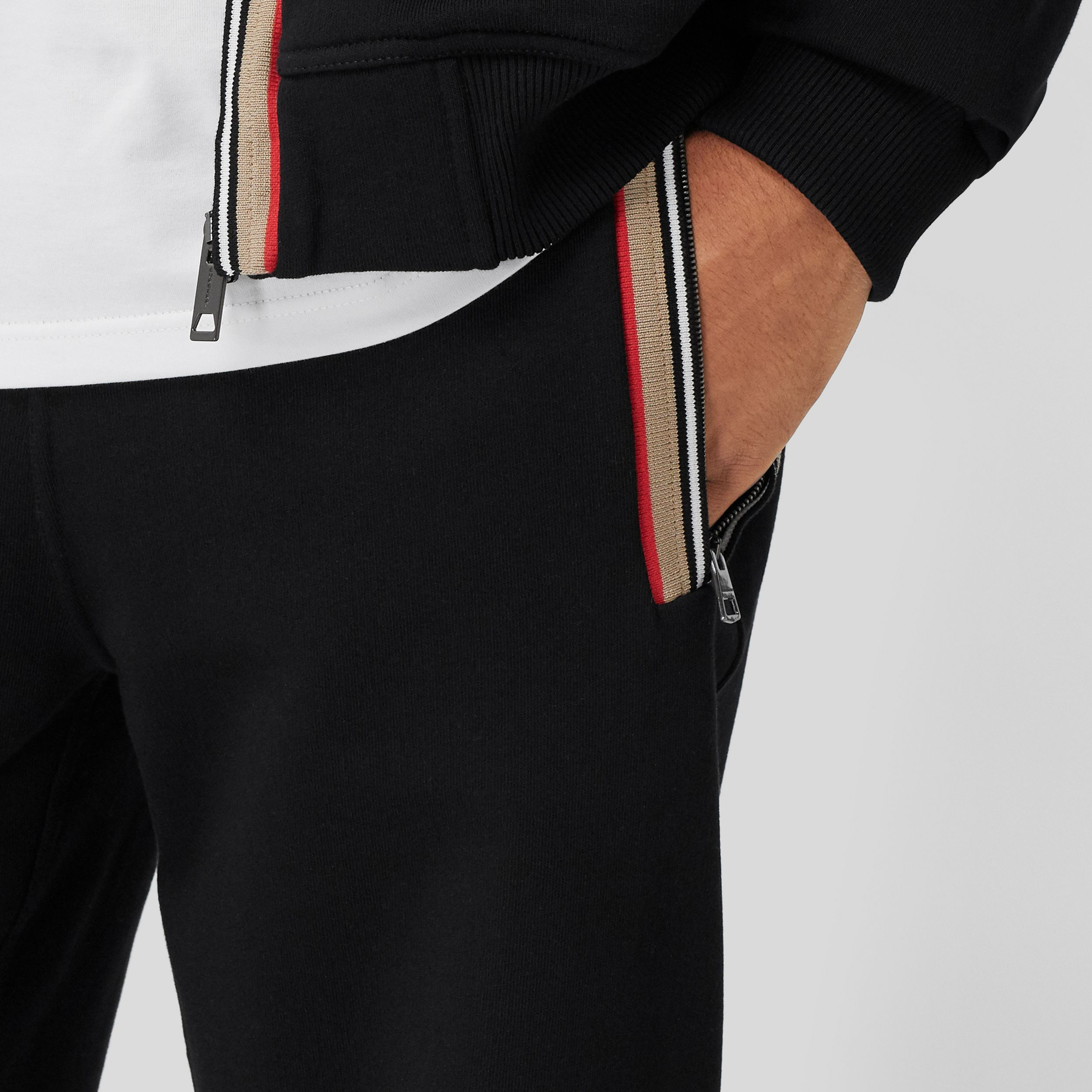 Icon Stripe Detail Cotton Jogging Pants in Black - Men | Burberry - 2