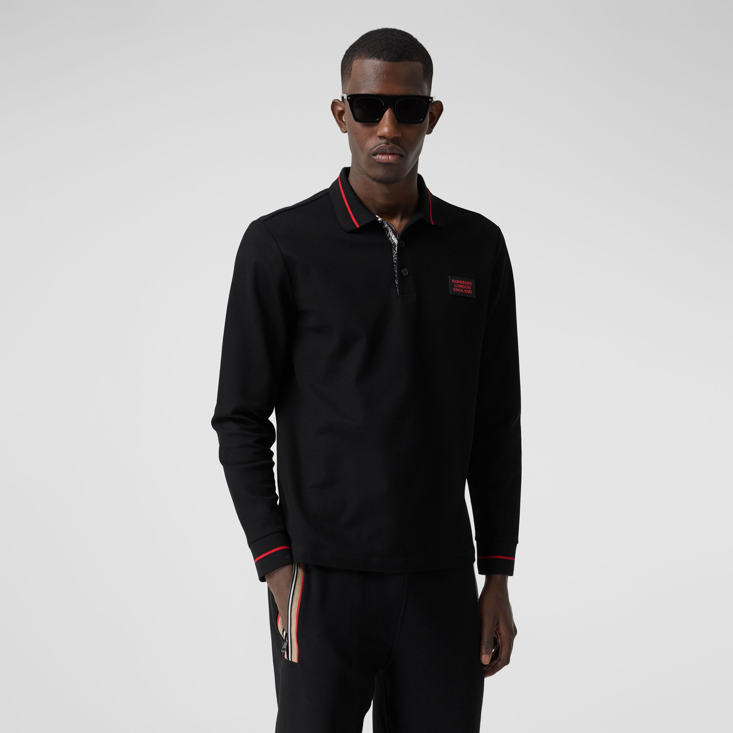 Long-sleeve Logo Appliqué Cotton Polo Shirt in Black - Men | Burberry - 1