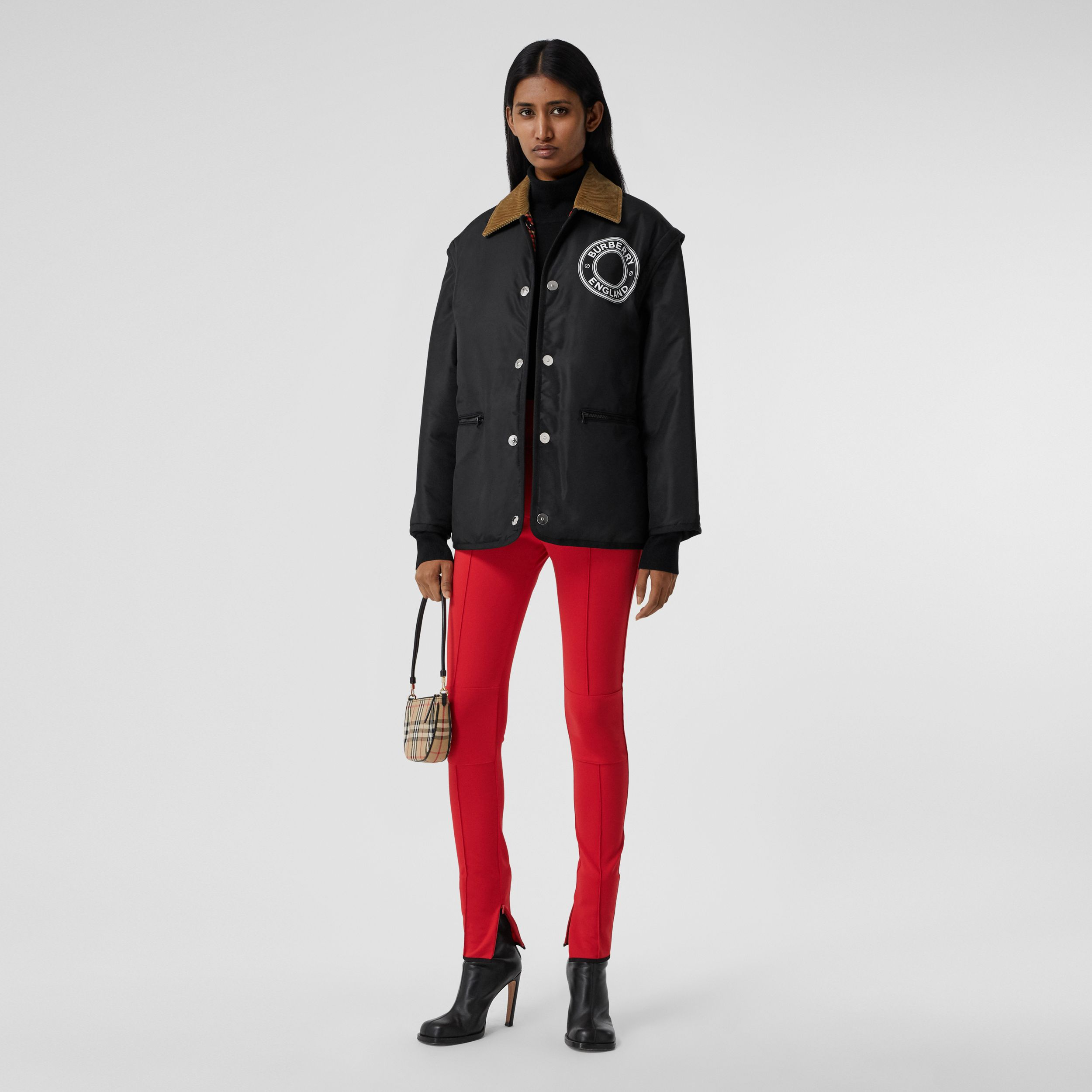 Detachable Sleeve Reversible Logo Graphic Jacket in Black - Women | Burberry - 1