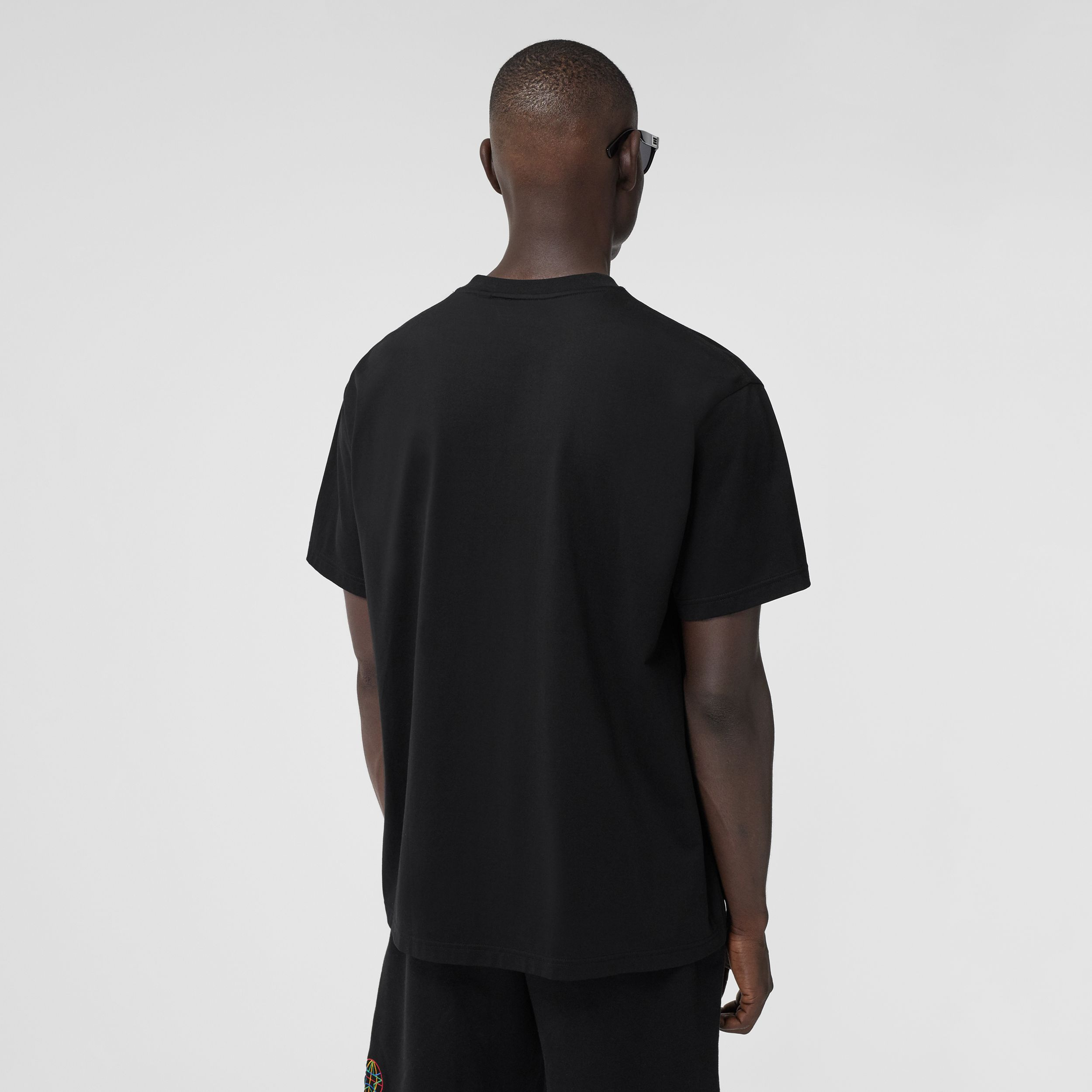 Embroidered Globe Graphic Cotton Oversized T-shirt in Black - Men | Burberry Australia - 3