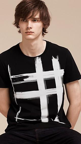 Camiseta en algodón con estampado de checks a pinceladas