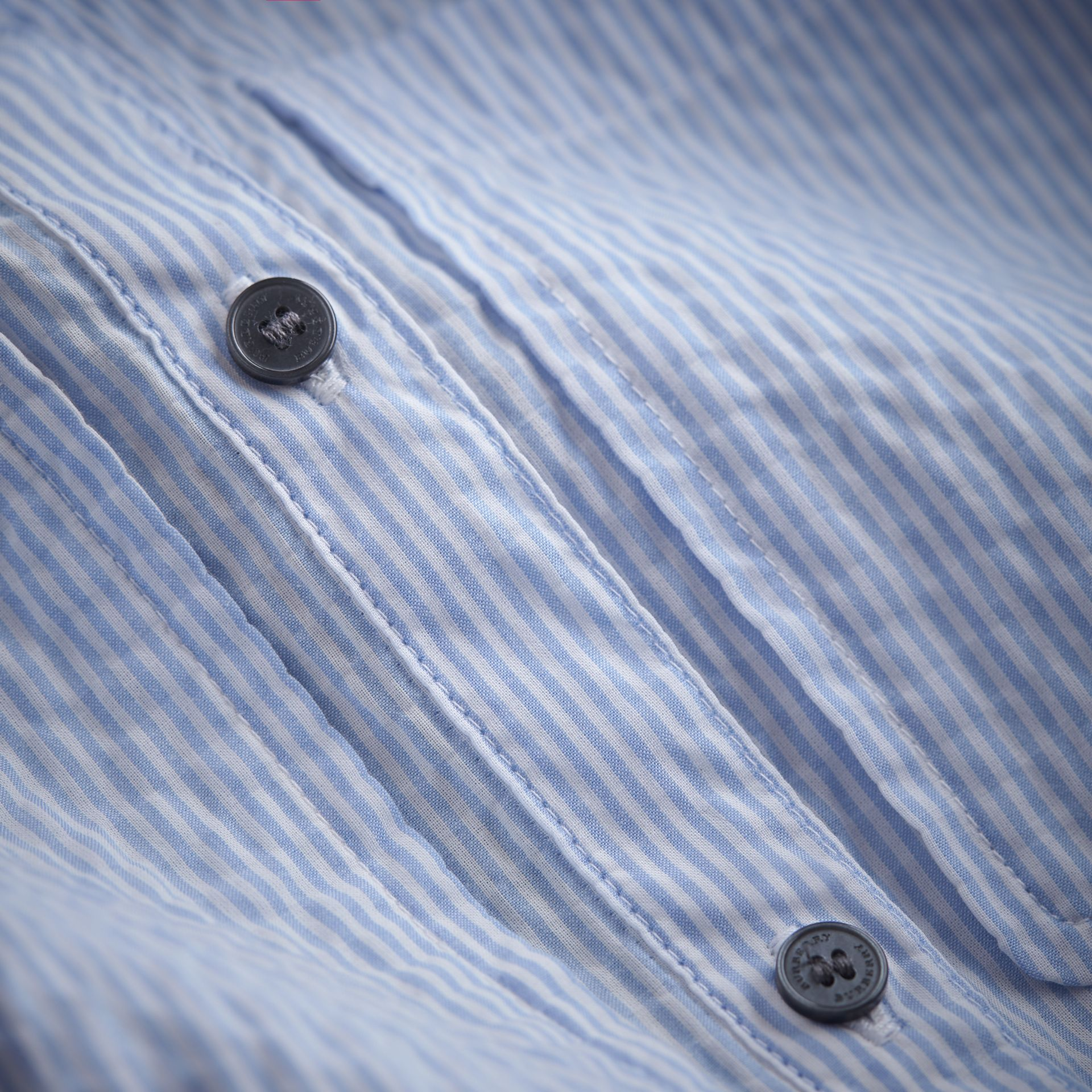 Bow Detail Striped Cotton Seersucker Shirt in Light Blue | Burberry - gallery image 1
