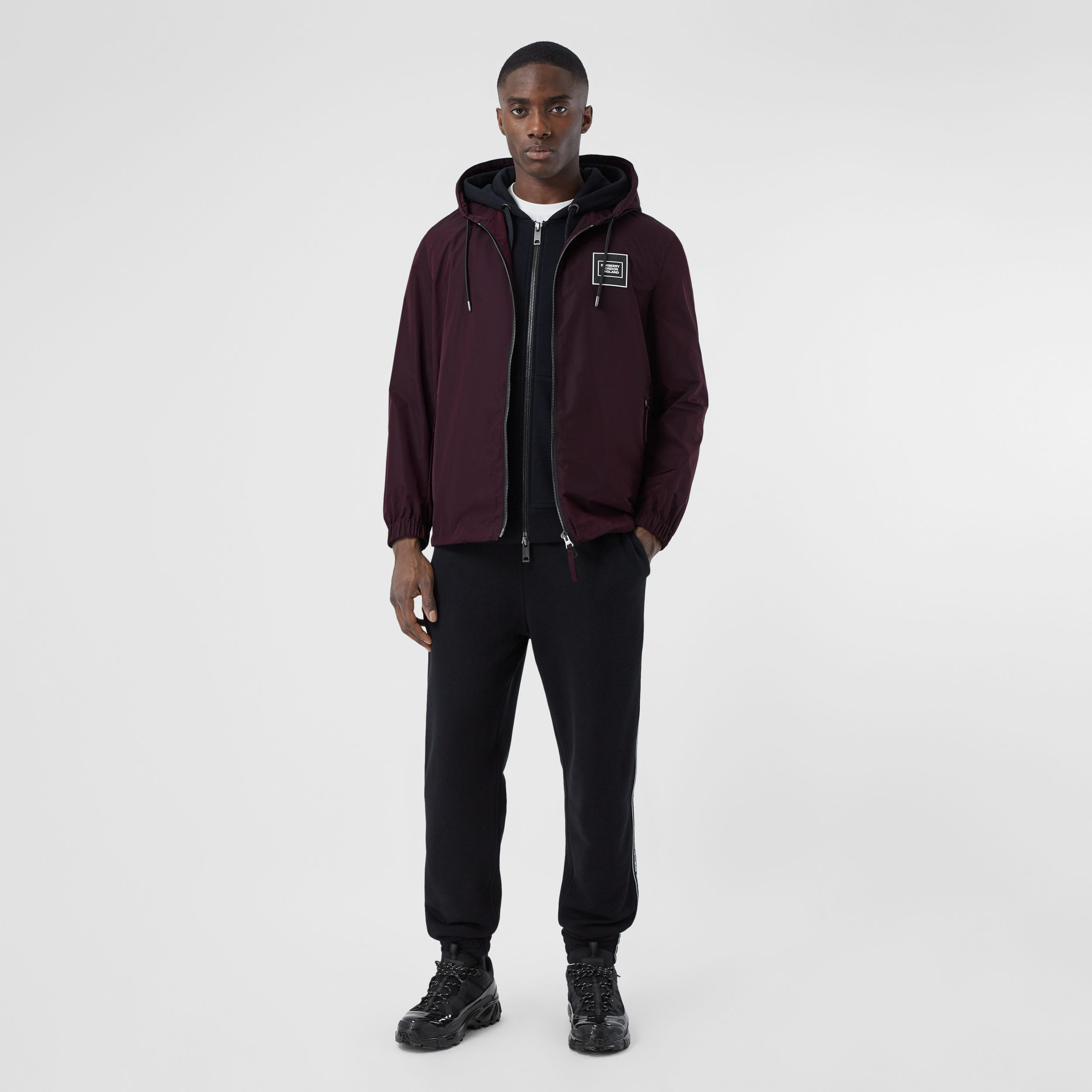 Logo Appliqué Shape-memory Taffeta Hooded Jacket in Elderberry - Men | Burberry - 1