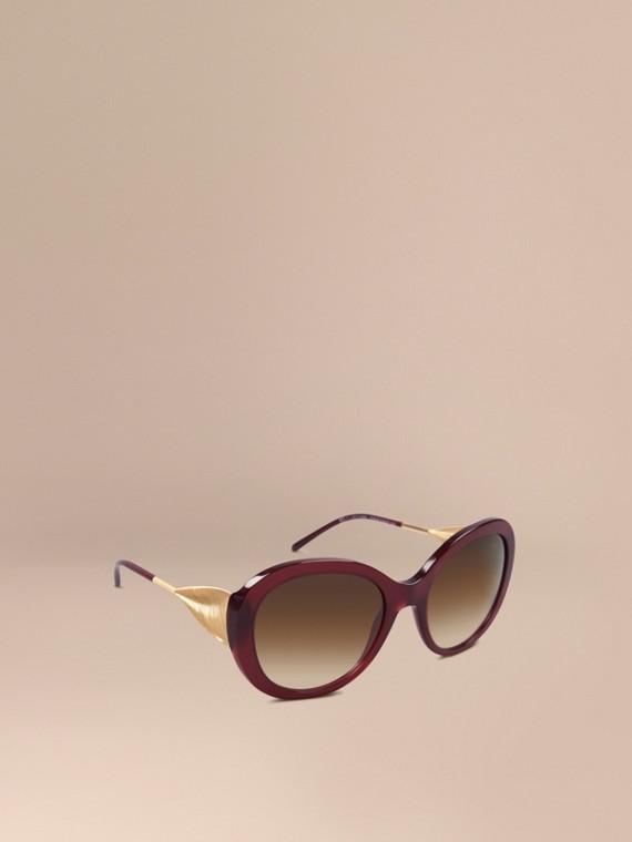Extragroße Sonnenbrille mit rundem Gestell Ochsenblutfarben