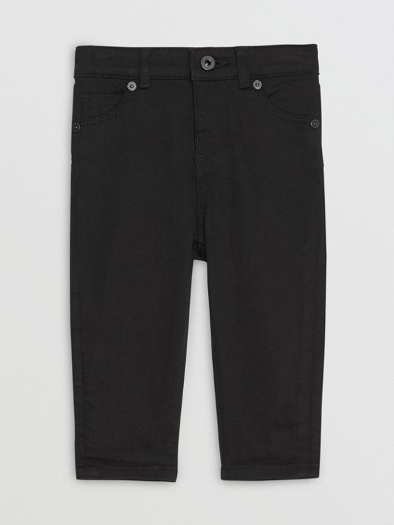 Jeans attillati in denim stretch (Nero)