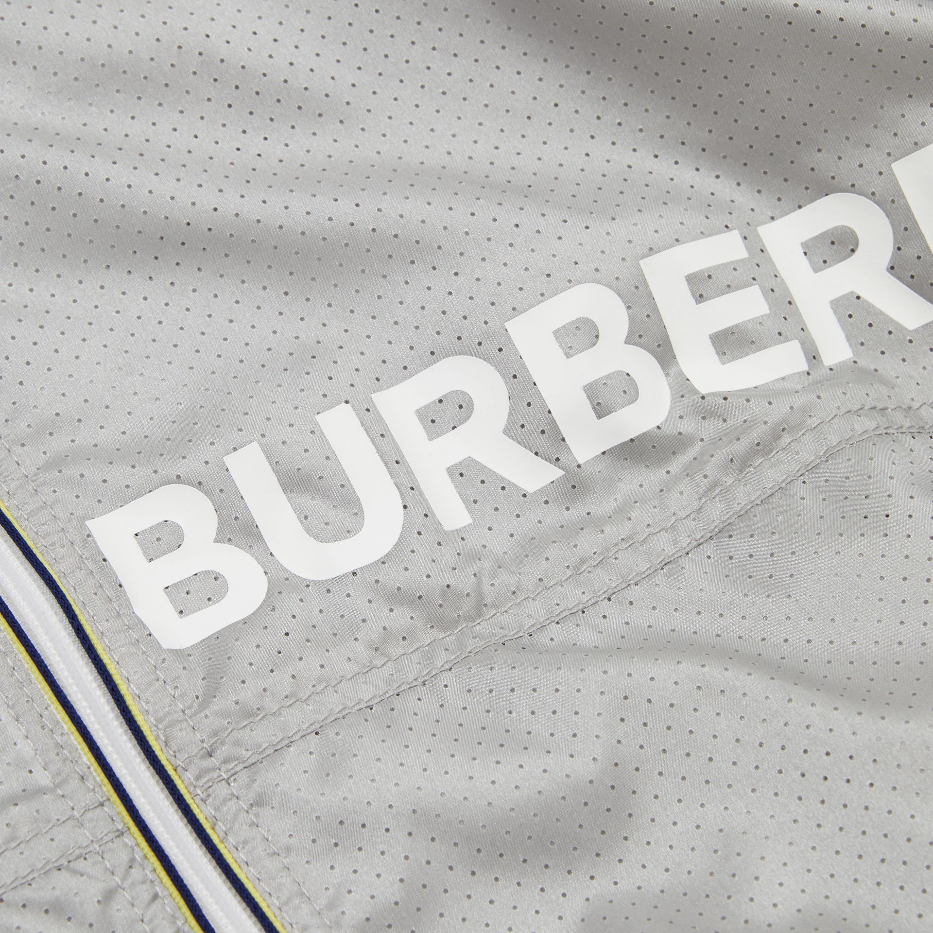 Logo Print Perforated Hooded Jacket in Silver | Burberry - gallery image 1
