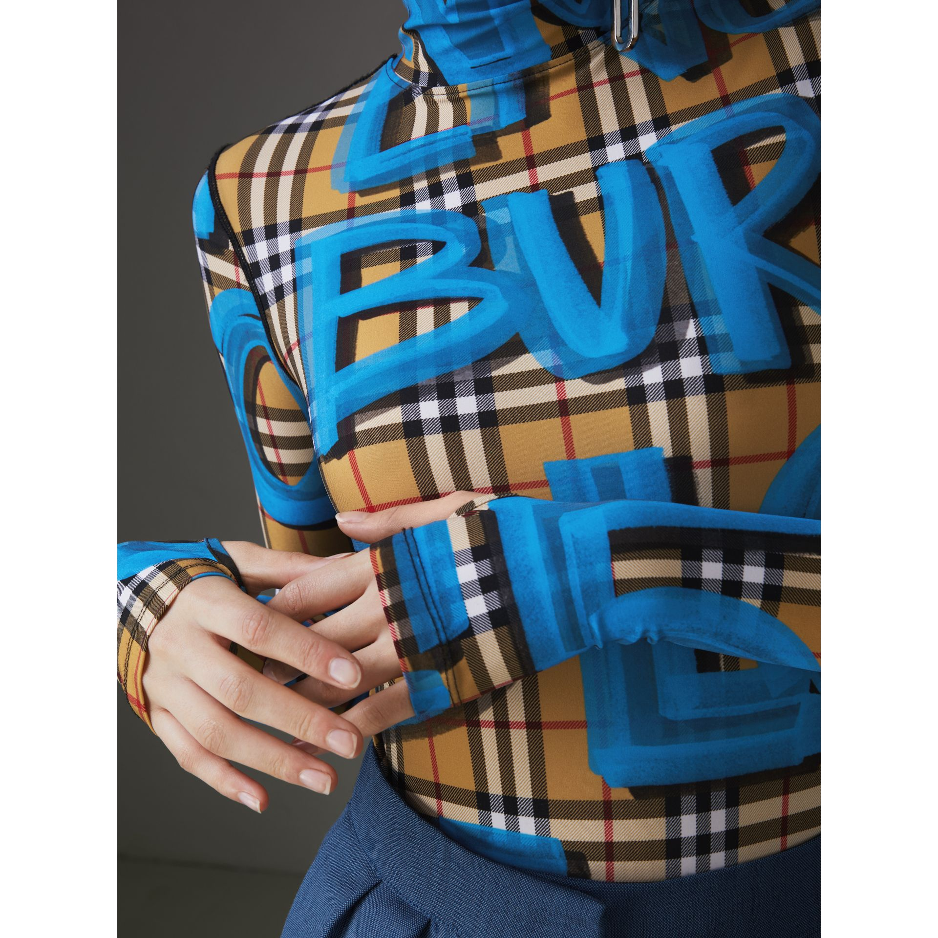 Graffiti Vintage Check Jersey Turtleneck Bodysuit in Bright Blue - Women | Burberry United States - gallery image 1