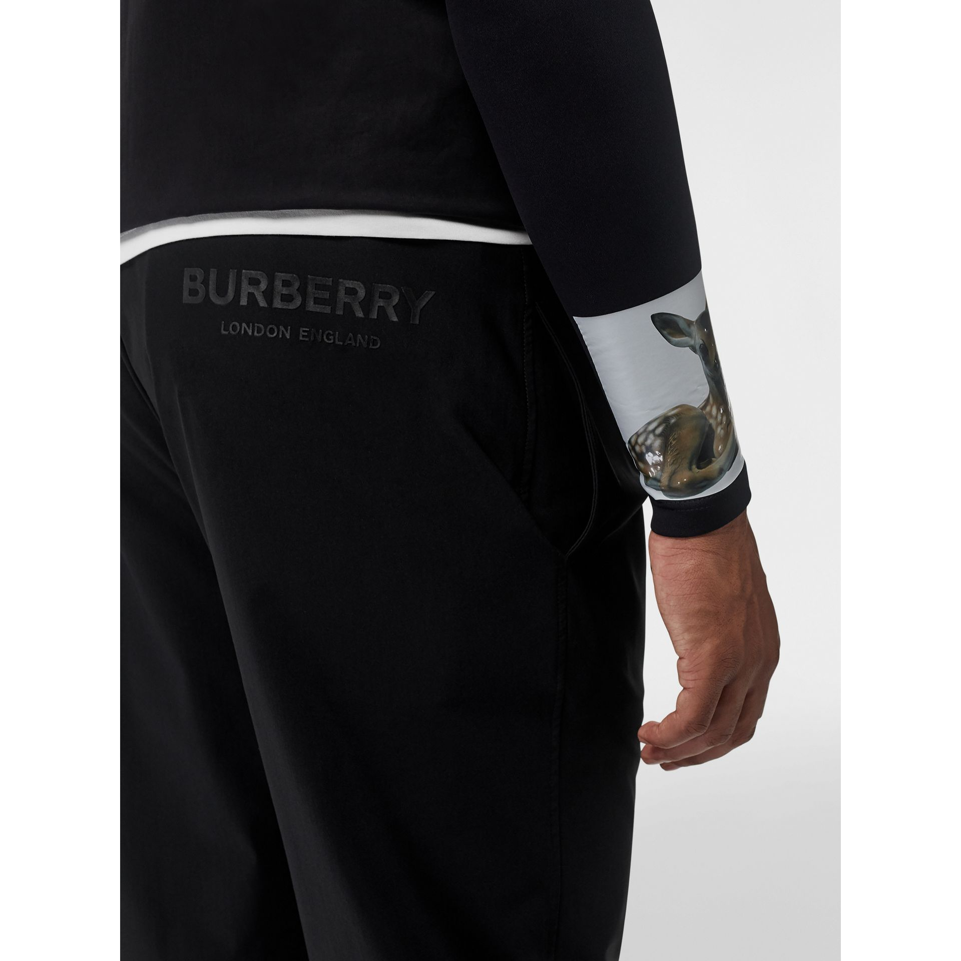 Logo Print Stretch Nylon Trackpants in Black - Men | Burberry - gallery image 1