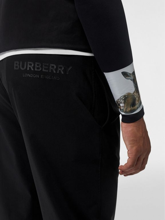 Logo Print Stretch Nylon Trackpants in Black - Men | Burberry United Kingdom - cell image 1