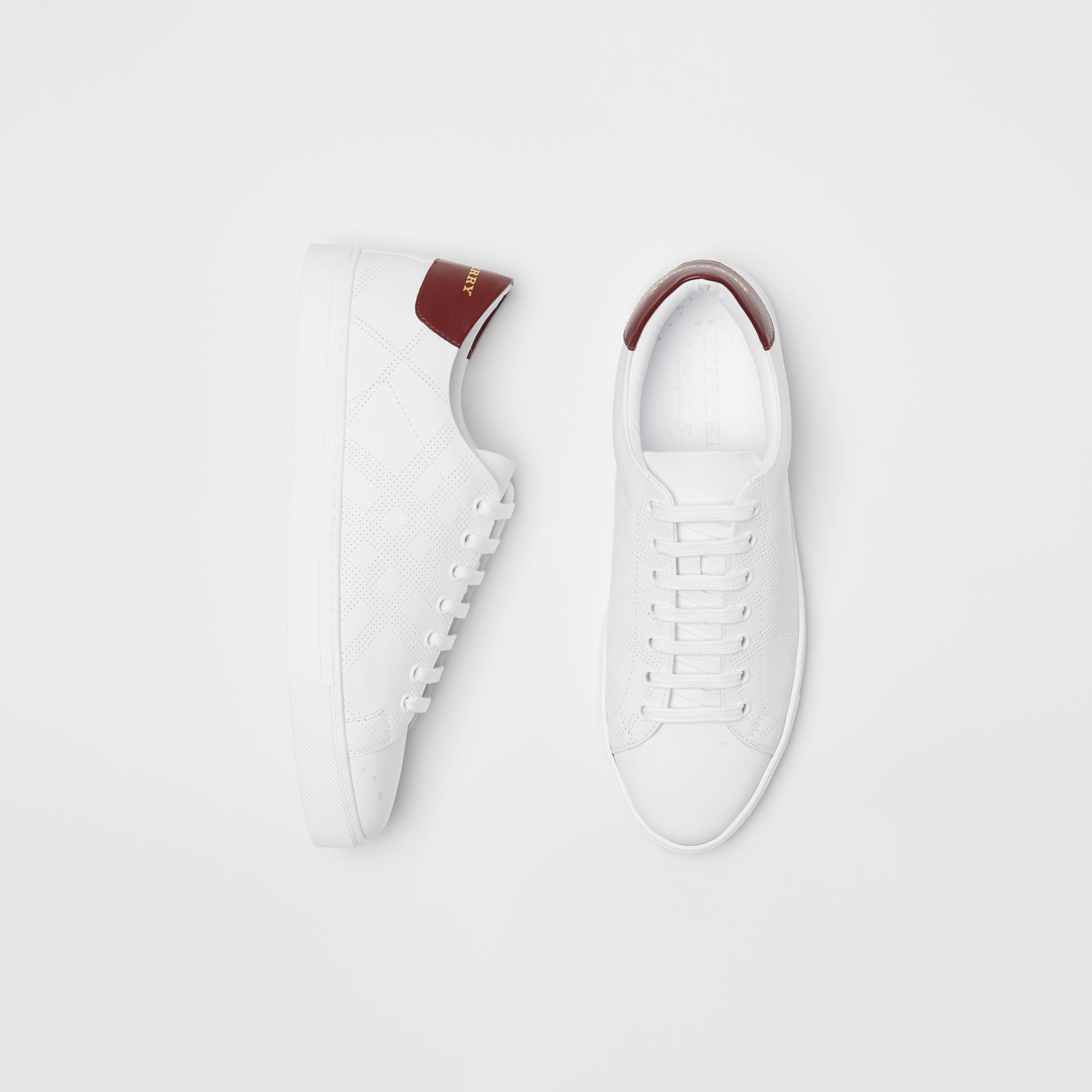 Perforated Check Leather Sneakers in Optic White - Men | Burberry - gallery image 0